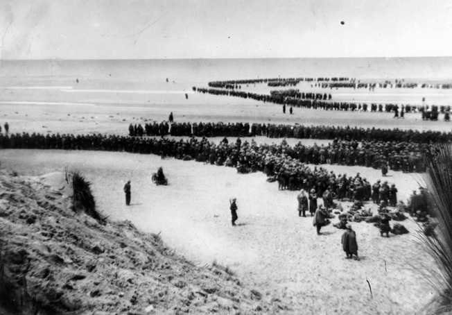 Among the most famous images captured during the evacuation of Dunkirk was this: the image of thousands of British troops waiting on the sands of the French coast in the hopes of being evacuated. Photo source: Warfare History Network.