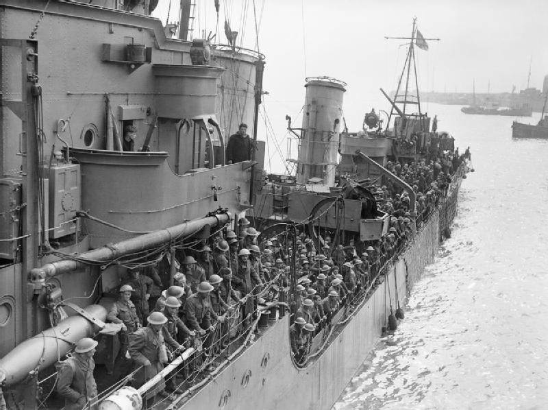 British soldiers crowded aboard a destroyer following evacuation prepare to dock at Dover on 31 May. Photo source: Wikipedia.