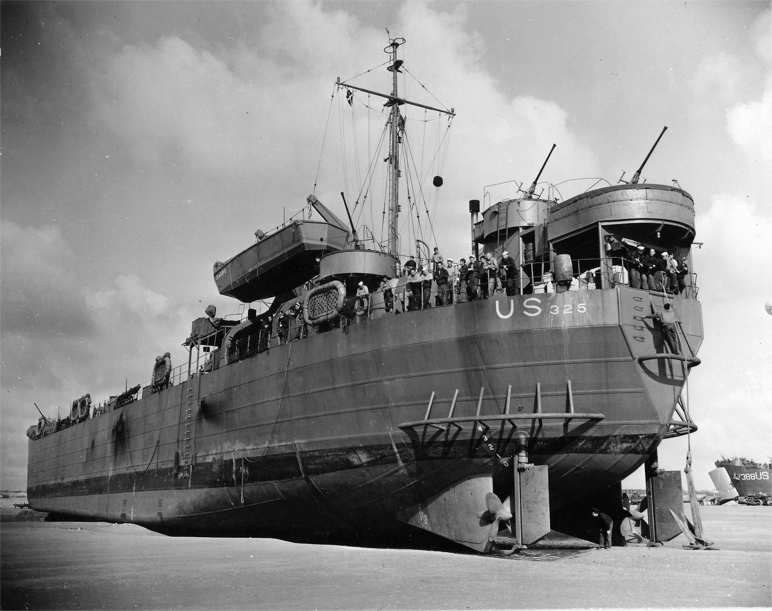 USS LST-325 beached off the coast of Normandy at low tide on June 12, 1944. Photo source: Navsource.org.