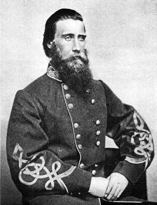 John Bell Hood began his military career with education at West Point. After graduating in 1853, Hood served in outposts in California and Texas as well as as a cavalry instructor at West Point. Curiously, Hood had graduated in the same class as his opposite number, John Schofield. Hood was considered an excellent division and brigade commander; as an officer in the Confederate army, Hood was wounded in the arm at Gettysburg and lost a leg at Chickamauga. He was appointed to command the Army of the Tennessee on July 18, 1864 at the age of 33, the youngest army commander on either side. Photo: Wikipedia.