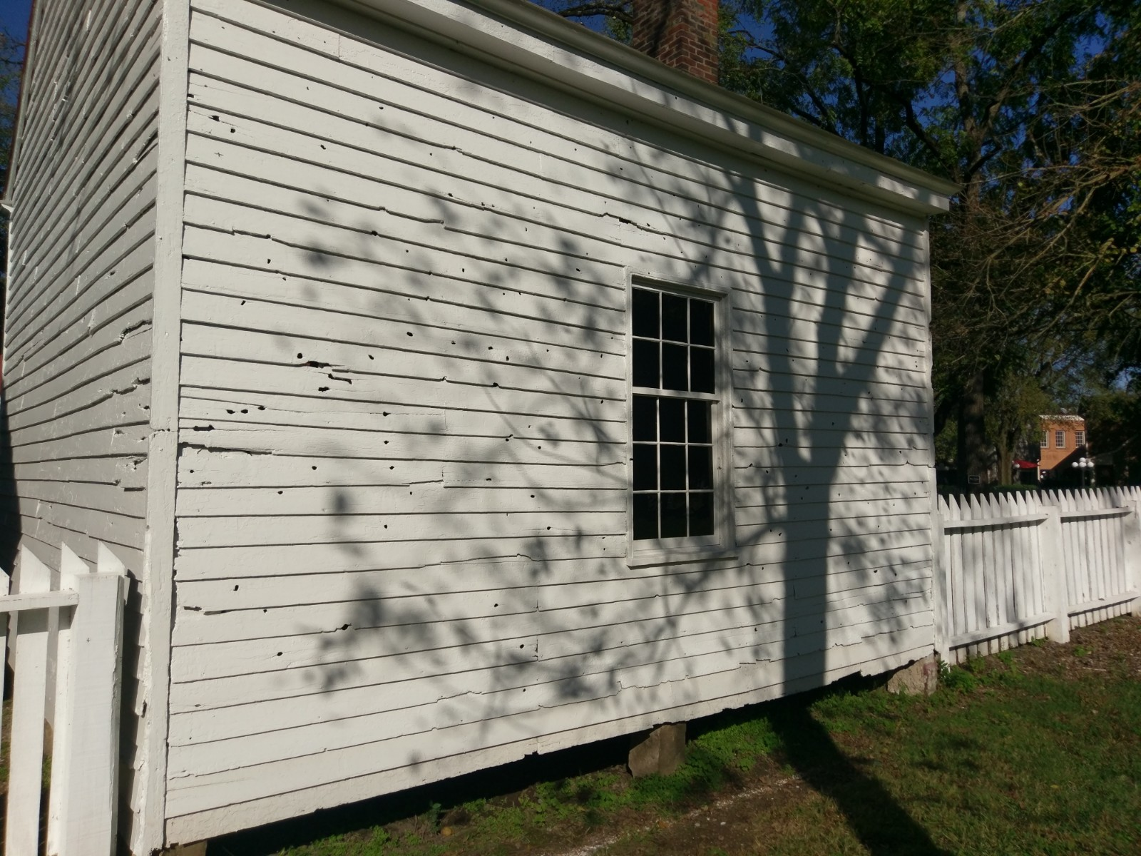 The Carter family office building- this structure is the most telling of all the buildings in the property- several bullets clearly penetrated completely through one side and out the other- the inside of the building shines with numerous rays from the hundreds of holes in the walls. Photo: Author.