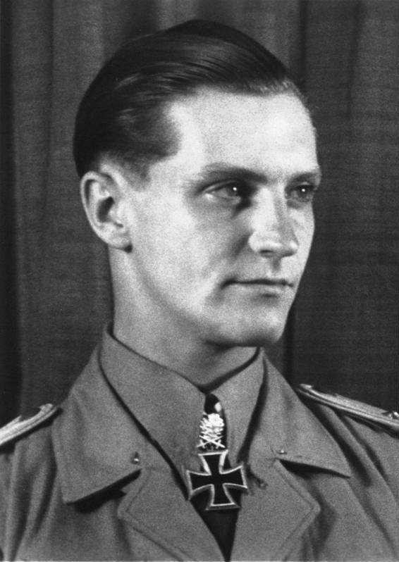 Hans Joachim-Marseille was one of the more remarkable pilots in the Luftwaffe who scored the bulk of his 158 victories while flying over Africa. He began his combat career during the Battle of Britain, where he developed a penchant for insubordination. Reassigned to Africa in April 1941, he quickly began accumulating aerial victories. He was only 23 at the time of his death in September 1942, when died trying to bail out of his disabled aircraft- he impacted the tail surface of the aircraft, likely knocking him unconscious or killing him- he then fell to earth. Photo source: Wikipedia.