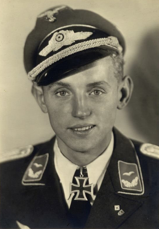 Erich Hartmann, nicknamed 'Bubi' for his youthful appearance, was the highest-scoring Bf-109 pilot of the war and the highest-scoring fighter ace in military history with 352 kills. What was perhaps most impressive about this figure is that he did not begin flying combat missions until November 1942. After being held as a prisoner by the Russians until 1955, Hartmann would later go on to serve as an officer in the postwar Luftwaffe. He died in 1991 at age 70. Photo source: Wikipedia.