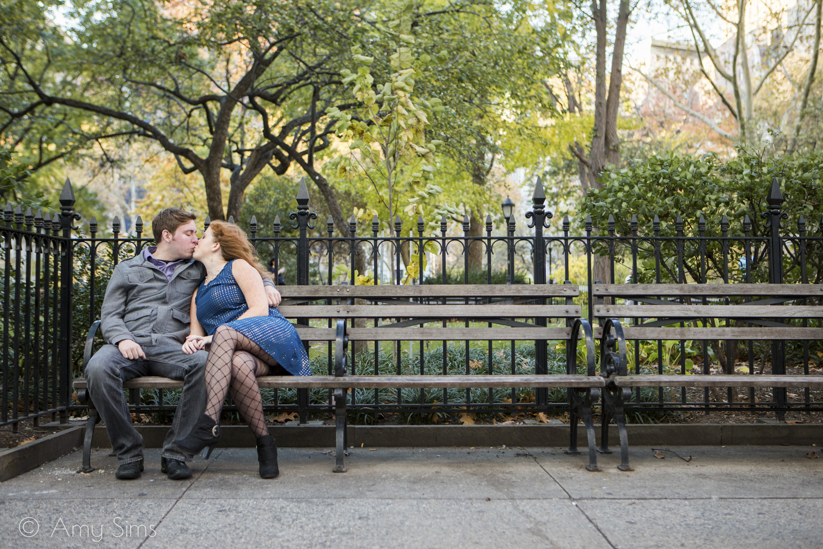 Couple shares a kiss on a bench | Madison Square Park Engagement | NYC Engagement | Ashley & Nick's Engagement | Amy Sims Photography