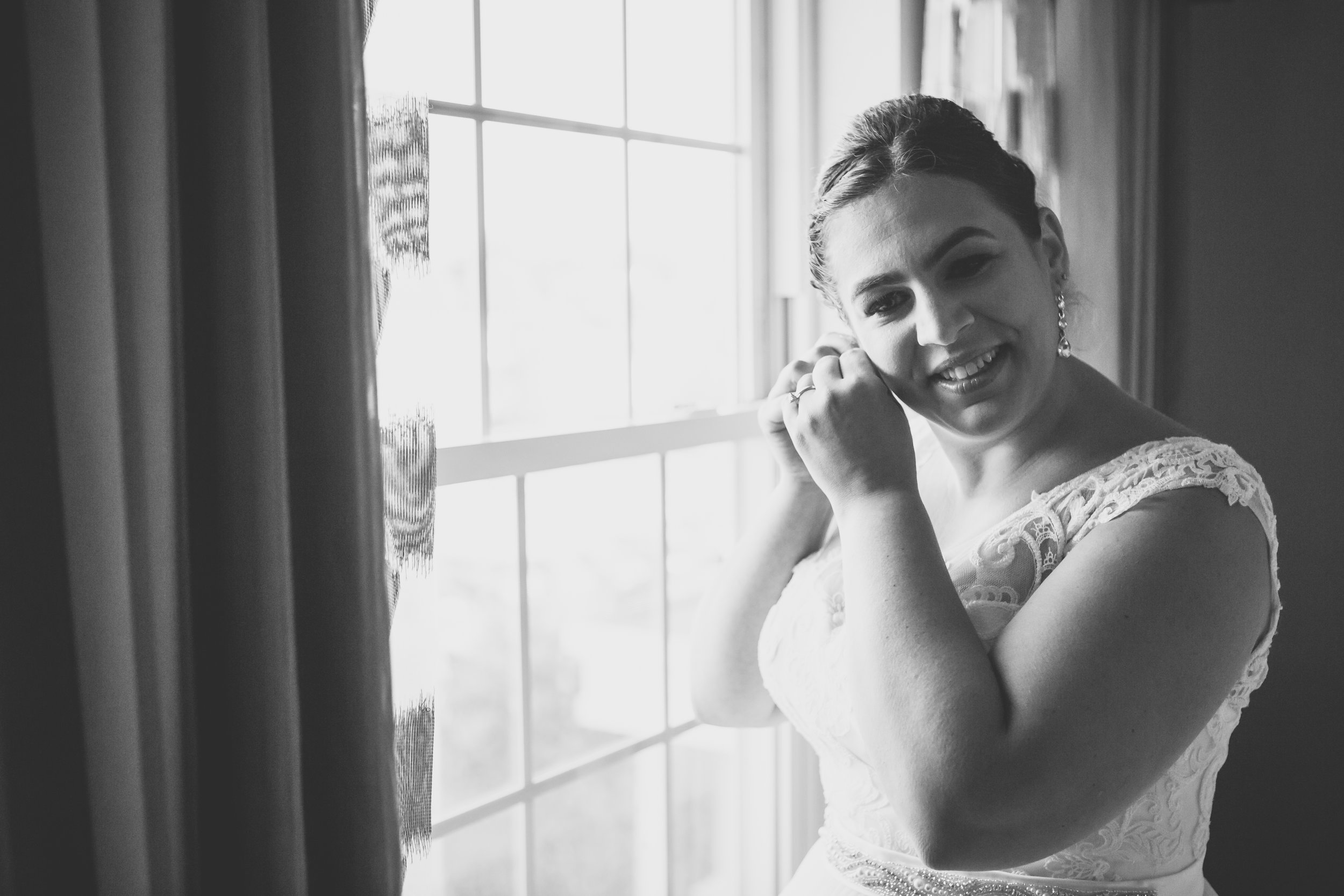 Bride puts on earrings - New Rochelle wedding - New York wedding - Hudson Valley wedding - Heather & Ian's wedding - Amy Sims Photography