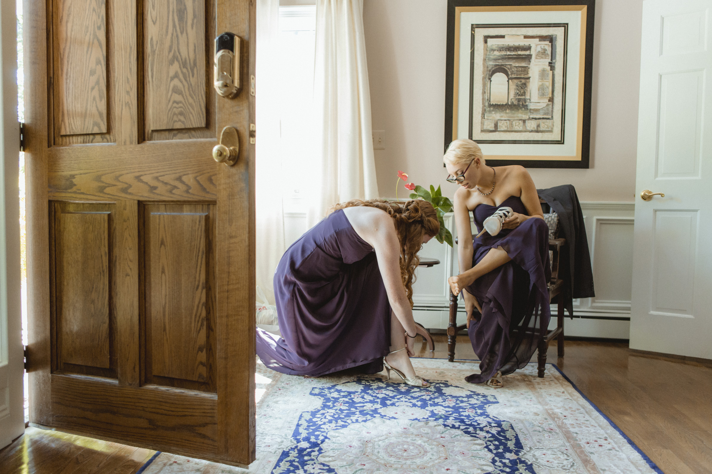 Bridesmaids put on their shoes - - Estate at Florentine Gardens wedding - Hudson Valley Wedding - Kelsey & Anish's wedding - Amy Sims Photography