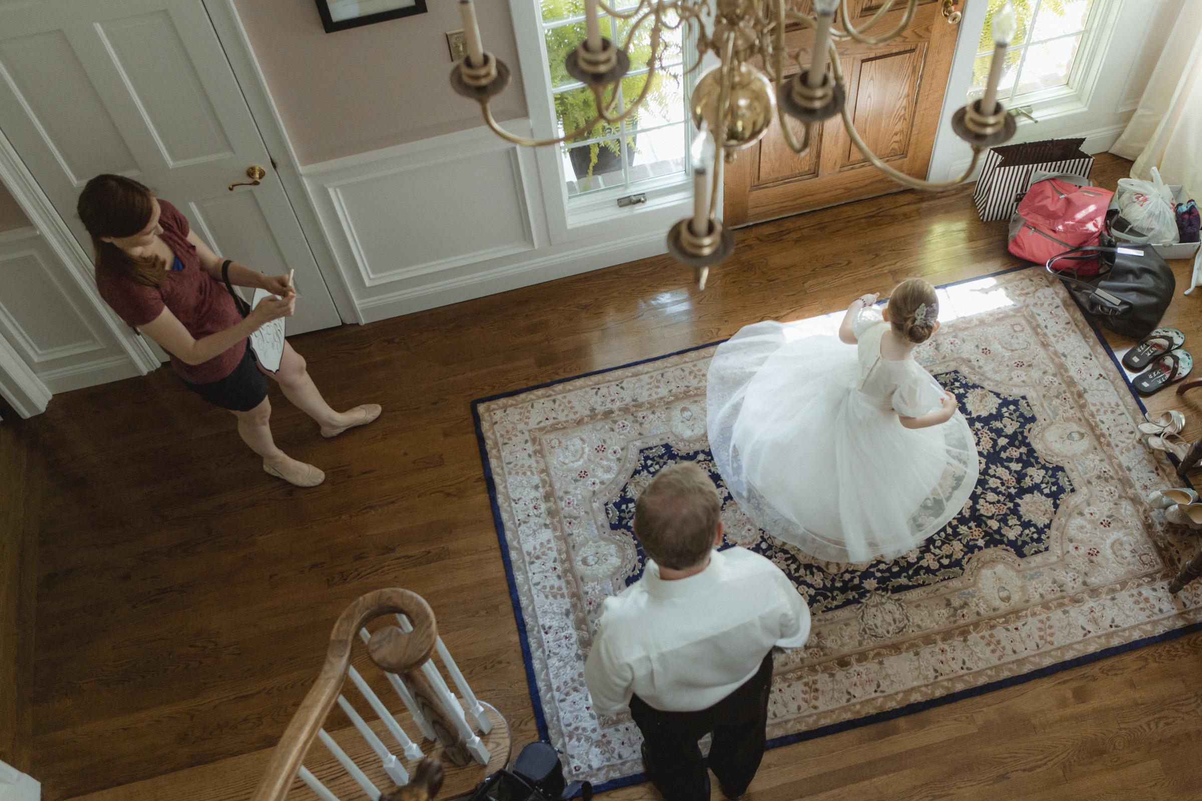 Flowergirl twirls in her dress - Estate at Florentine Gardens wedding - Hudson Valley Wedding - Kelsey & Anish's wedding - Amy Sims Photography