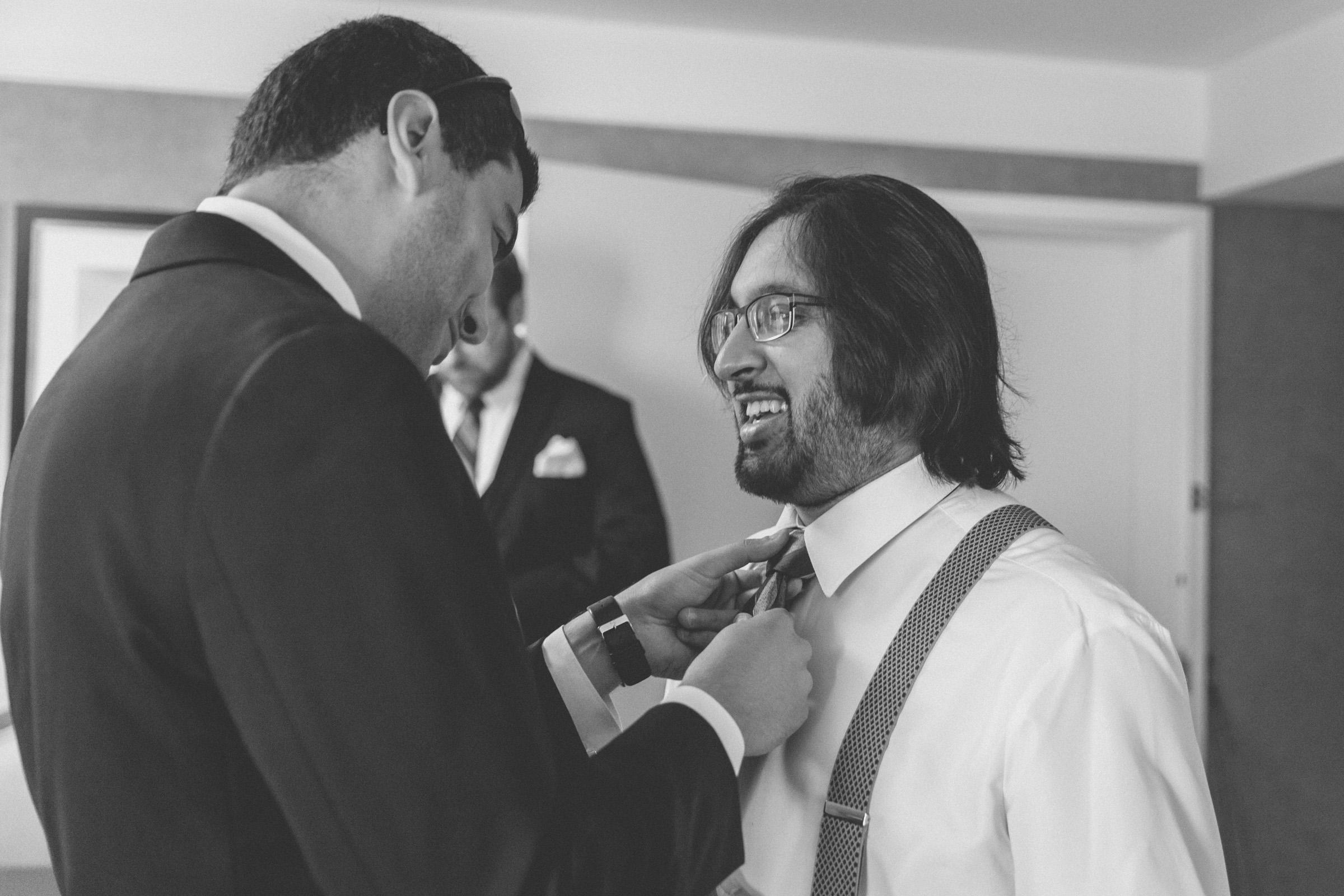 Groomsman fixes groom's tie - Estate at Florentine Gardens wedding - Hudson Valley Wedding - Kelsey & Anish's wedding - Amy Sims Photography