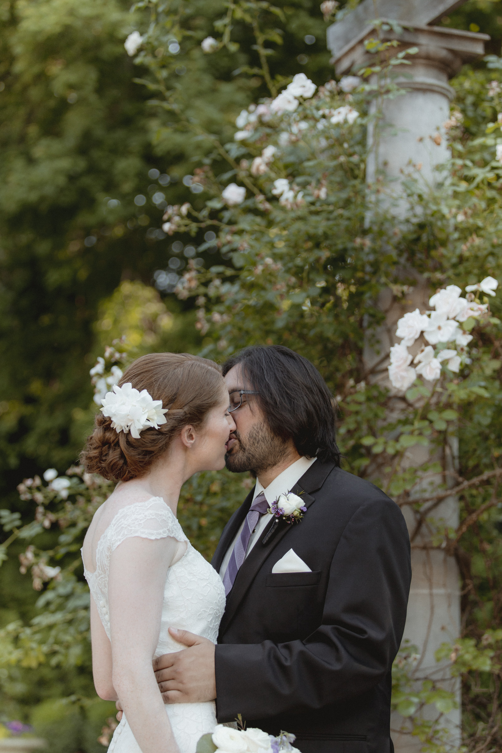 Couple shares a kiss in romantic garden - Estate at Florentine Gardens wedding - Hudson Valley Wedding - Kelsey & Anish's wedding - Amy Sims Photography