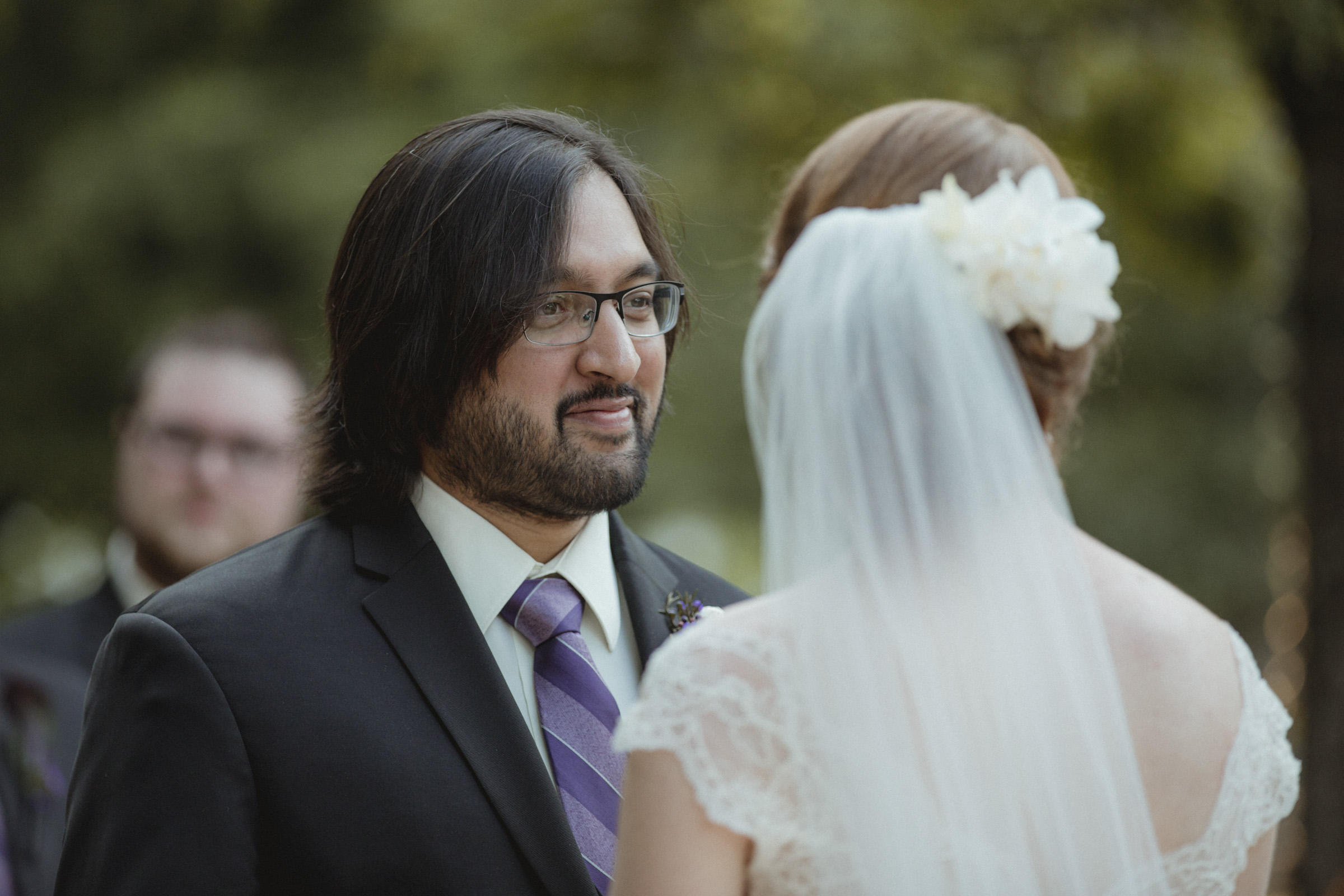 Groom smiles at his bride during ceremony - - Estate at Florentine Gardens wedding - Hudson Valley Wedding - Kelsey & Anish's wedding - Amy Sims Photography
