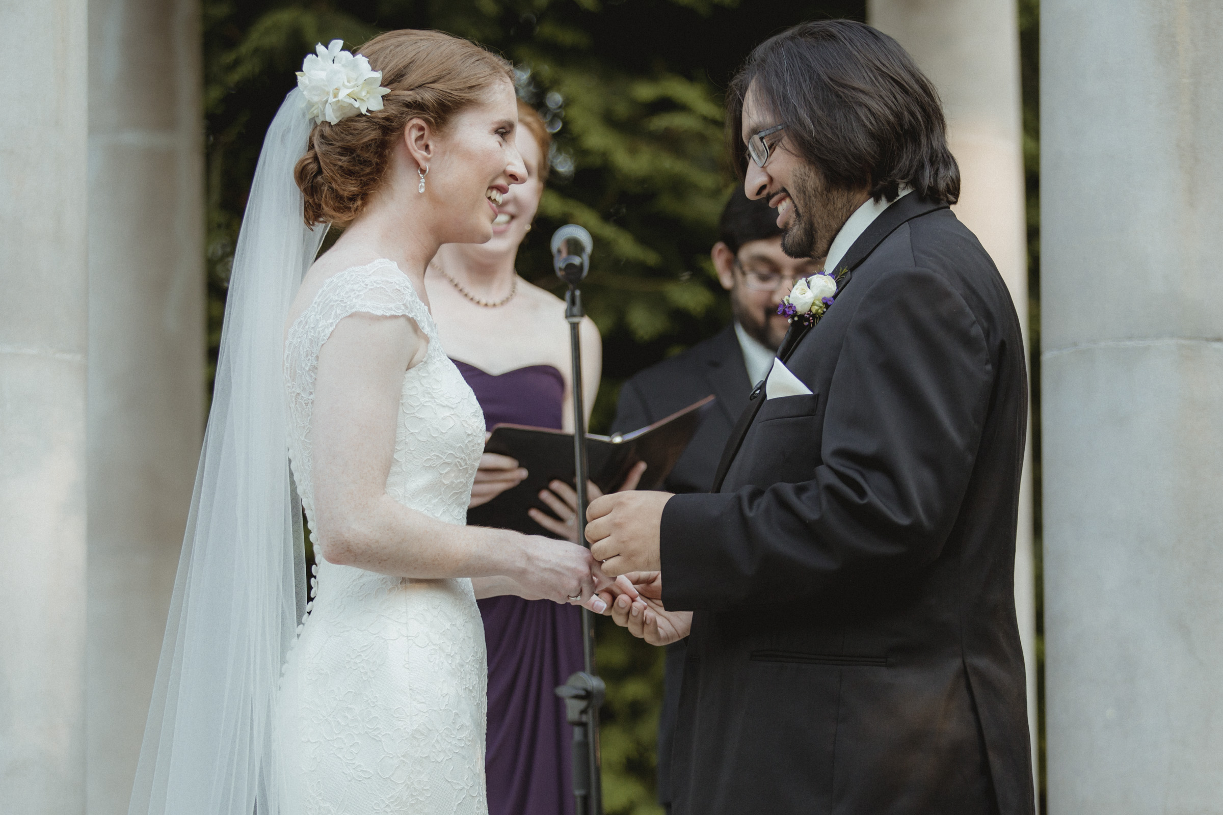 Groom laughs as he puts ring on bride's finger - Estate at Florentine Gardens wedding - Hudson Valley Wedding - Kelsey & Anish's wedding - Amy Sims Photography