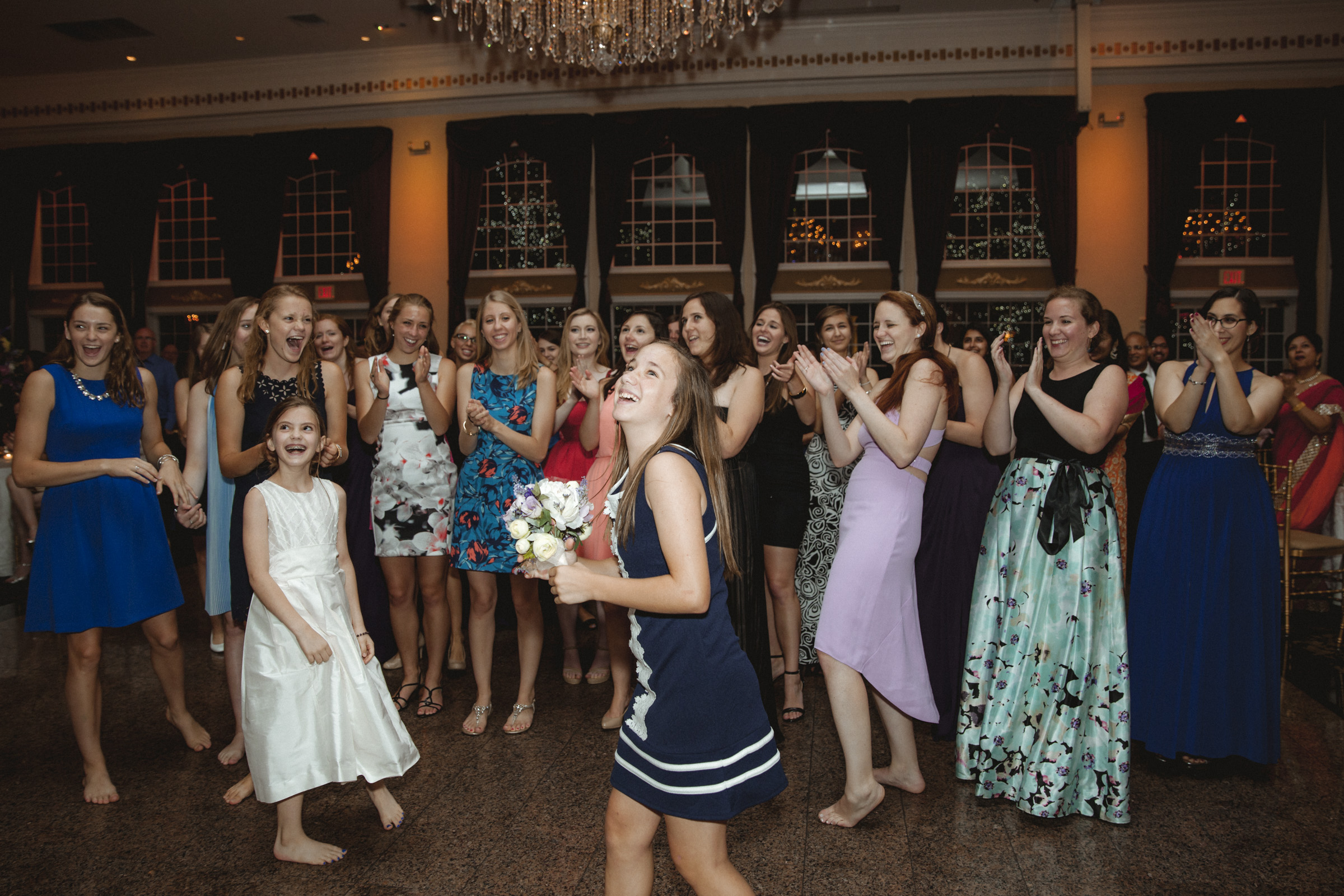 Girl catches the bouquet - Estate at Florentine Gardens wedding - Hudson Valley Wedding - Kelsey & Anish's wedding - Amy Sims Photography
