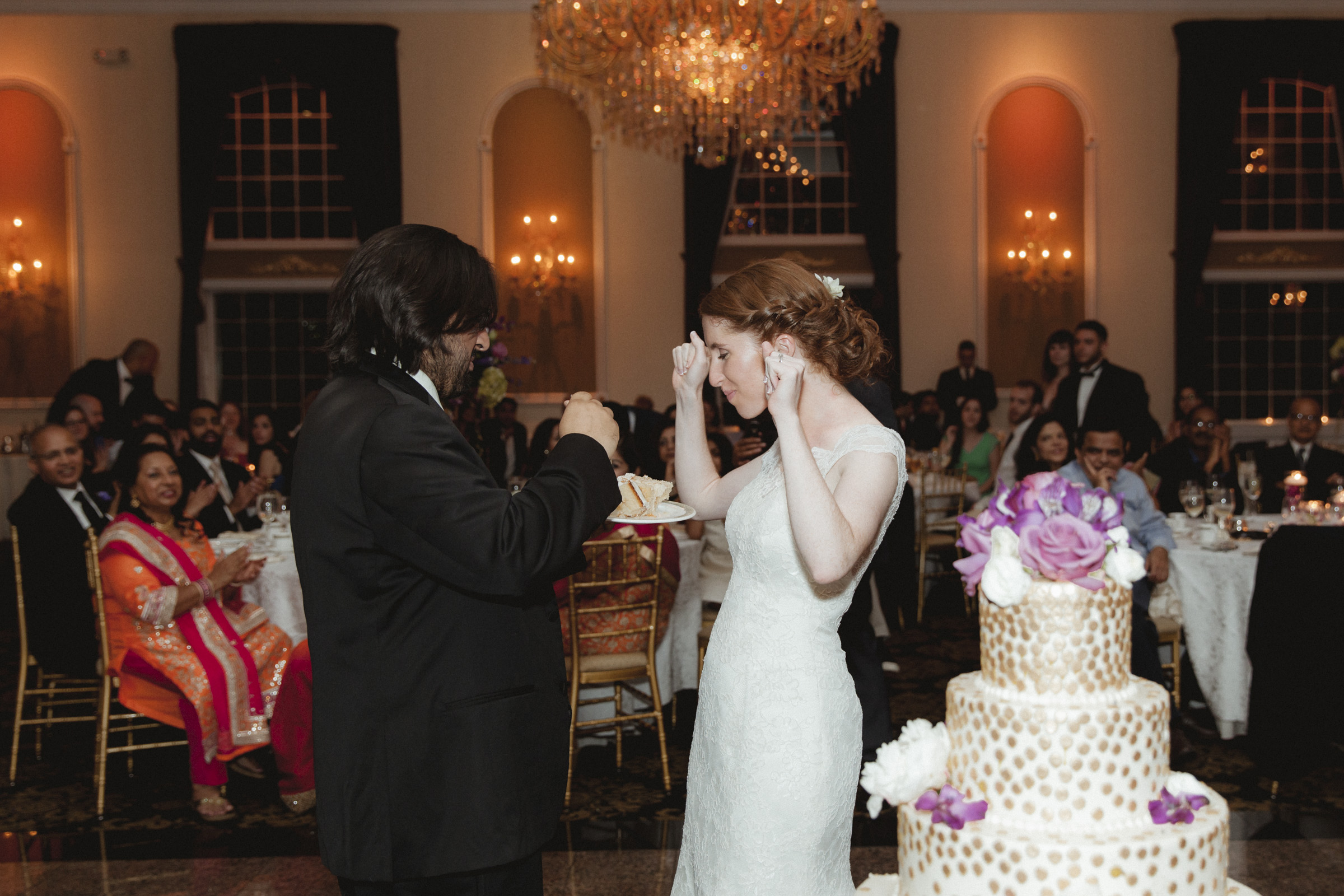 Groom feeds his bride cake - Estate at Florentine Gardens wedding - Hudson Valley Wedding - Kelsey & Anish's wedding - Amy Sims Photography