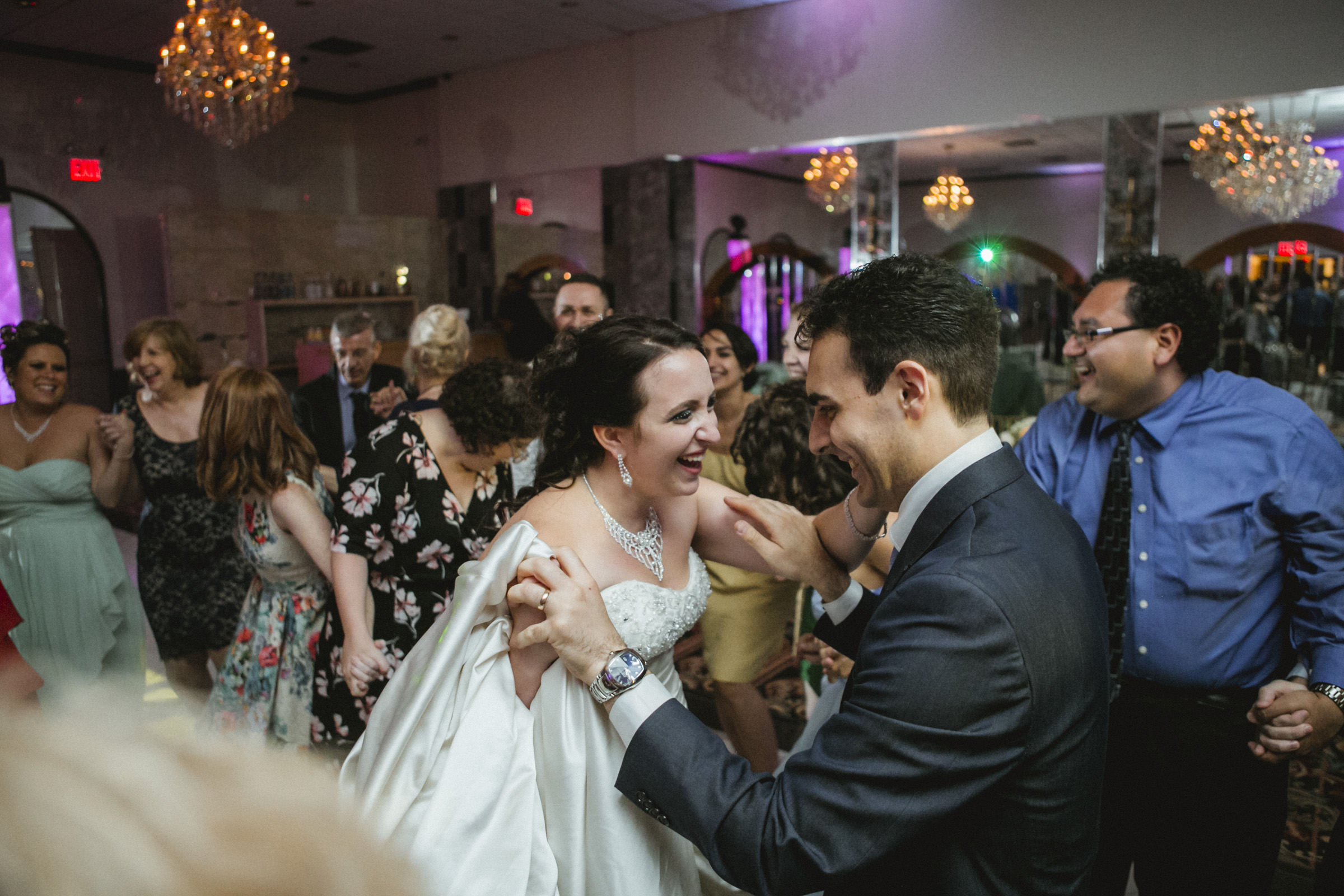 Guests dance, surrounding the newlyweds | Scavello's on the Island | Manhattan wedding | Bronx Wedding | Cathy & Antonello's wedding | Amy Sims Photography