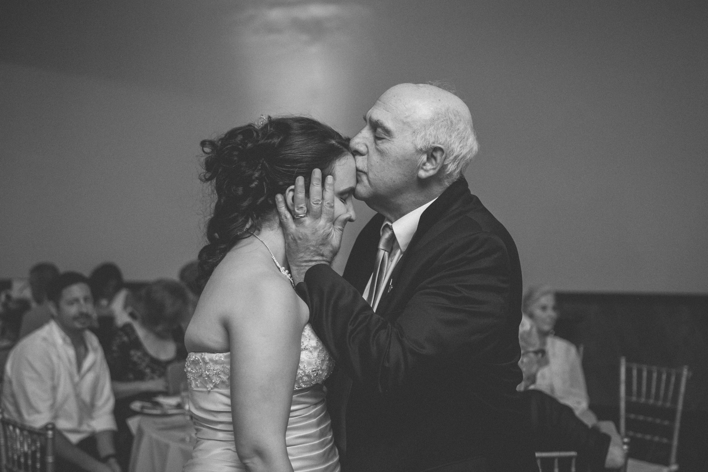 Bride gets a sweet forehead kiss from her godfather | Scavello's on the Island | Manhattan wedding | Bronx Wedding | Cathy & Antonello's wedding | Amy Sims Photography