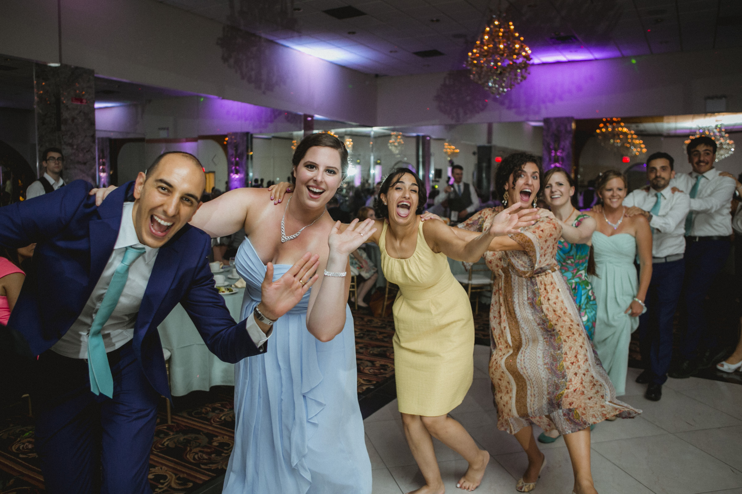 Guests wave during conga line | Scavello's on the Island | Manhattan wedding | Bronx Wedding | Cathy & Antonello's wedding | Amy Sims Photography