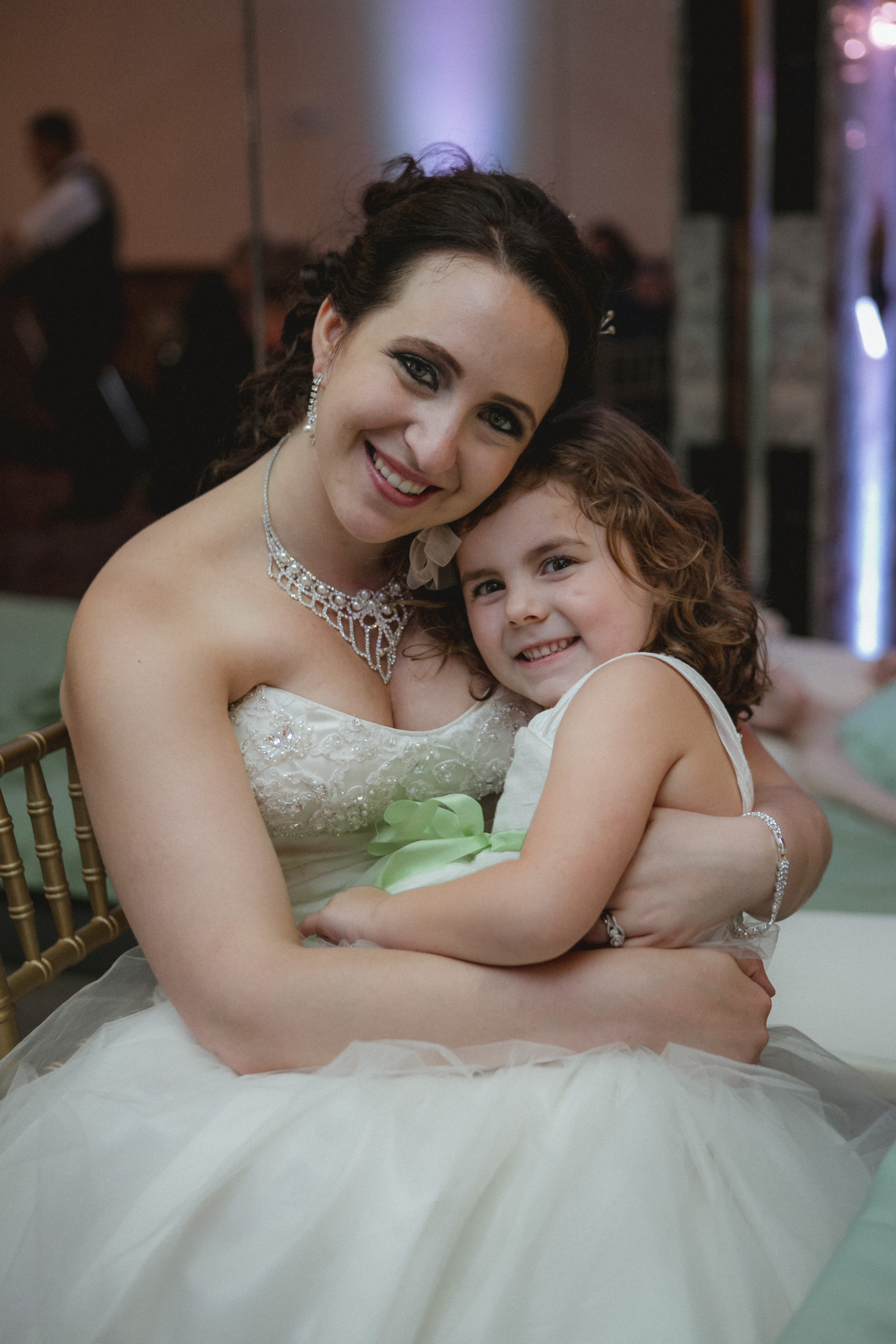Bride and flower girl snuggle up | Scavello's on the Island | Manhattan wedding | Bronx Wedding | Cathy & Antonello's wedding | Amy Sims Photography