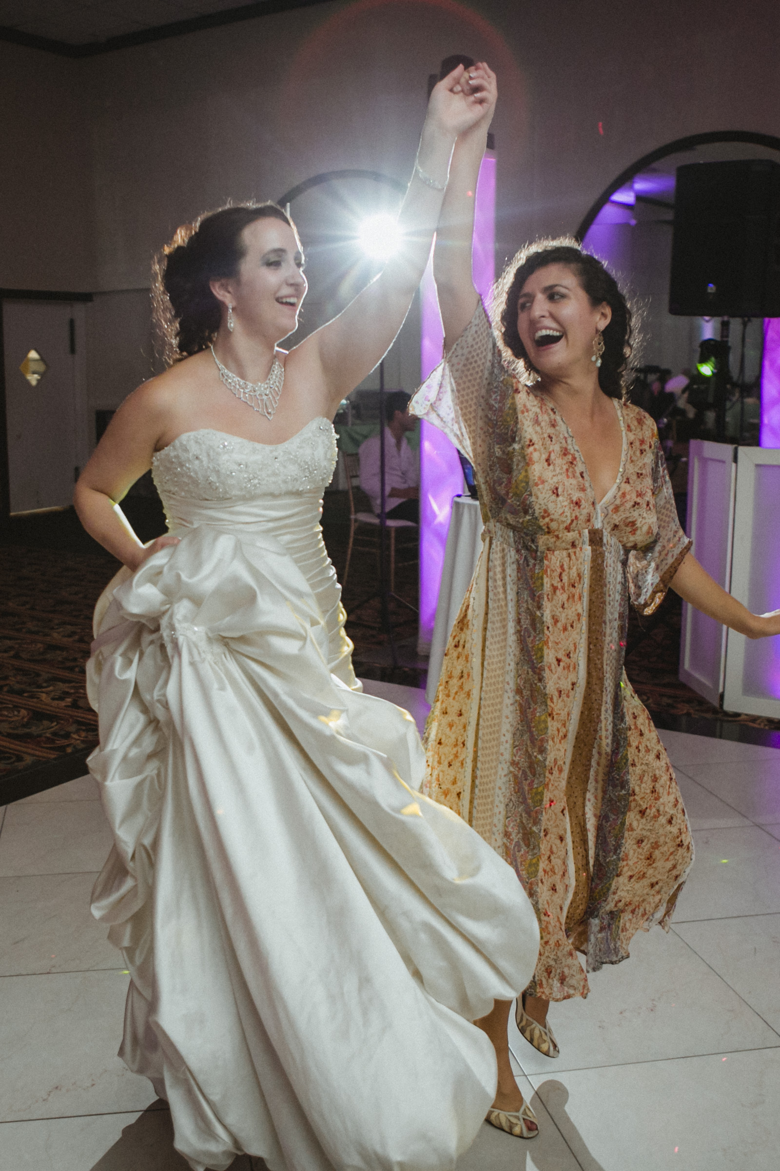 Bride dances with friend | Scavello's on the Island | Manhattan wedding | Bronx Wedding | Cathy & Antonello's wedding | Amy Sims Photography