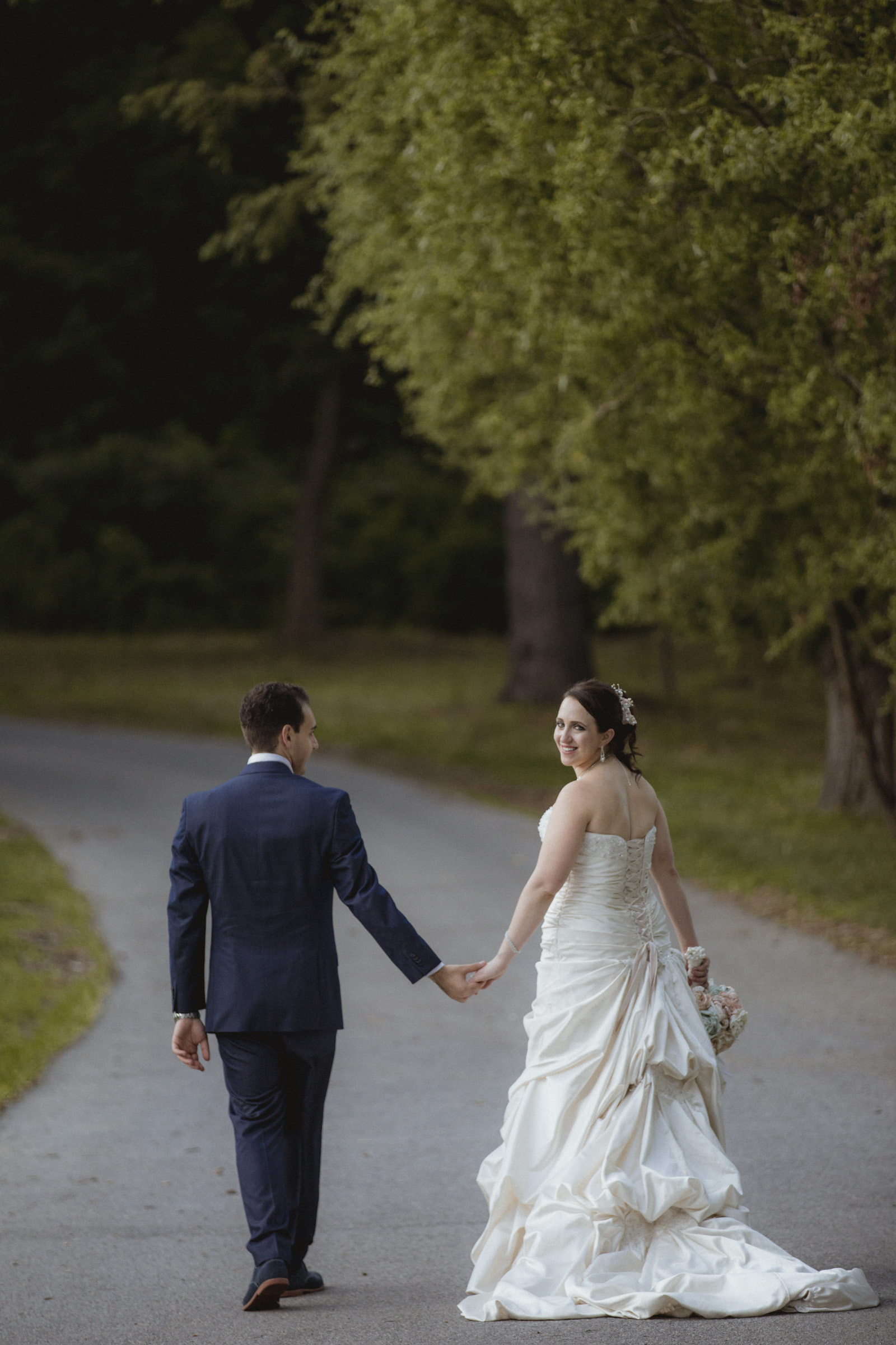 Couple stroll down a long road | Maggie Sottero gown | Sean John suit | Bartow-Pell Mansion wedding | Manhattan wedding | Bronx Wedding | Cathy & Antonello's wedding | Amy Sims Photography