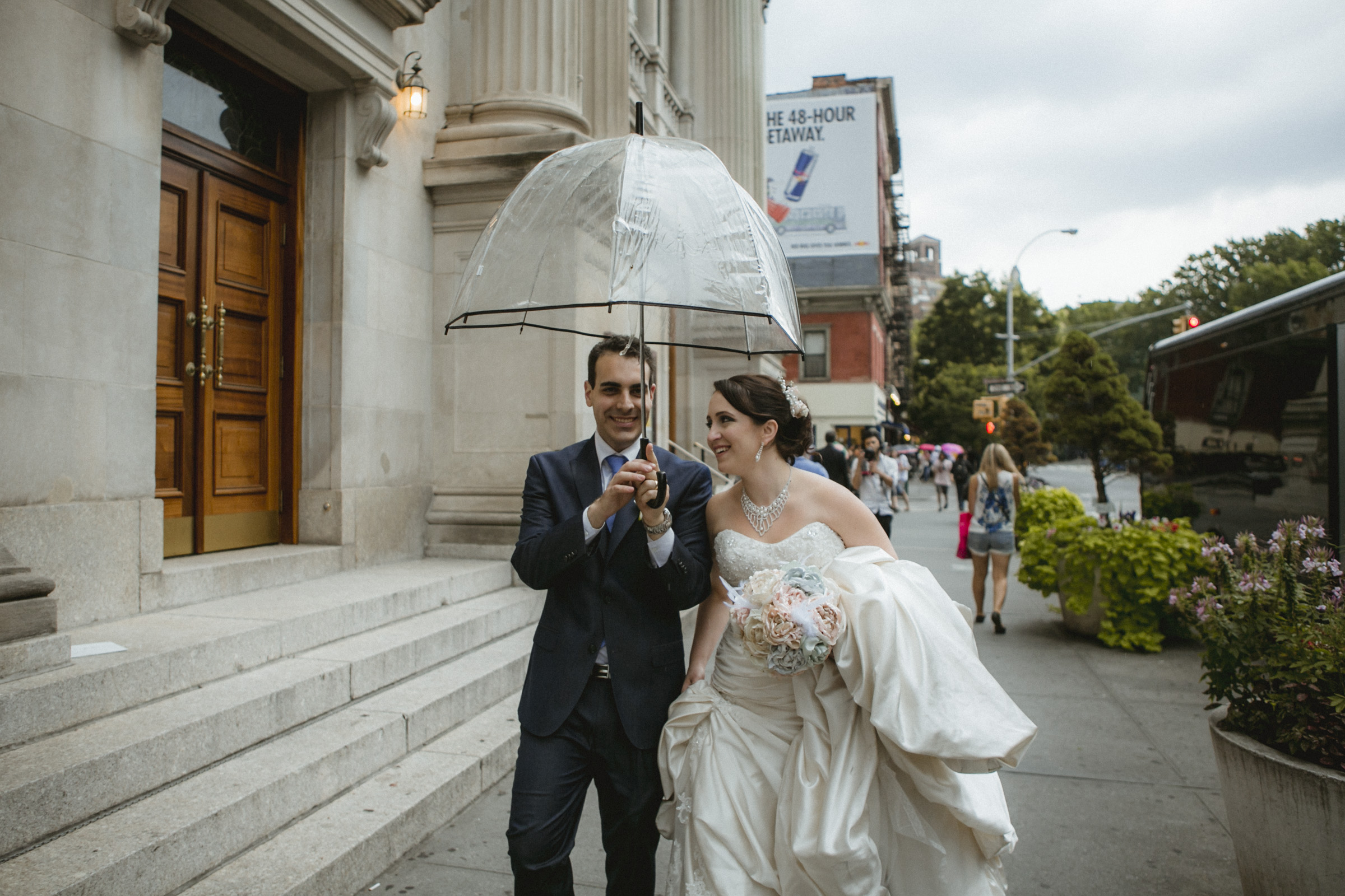 Newly weds share an umbrella out side the church after ceremony | Our Lady of Pompeii wedding | Manhattan wedding | Bronx Wedding | Cathy & Antonello's wedding | Amy Sims Photography