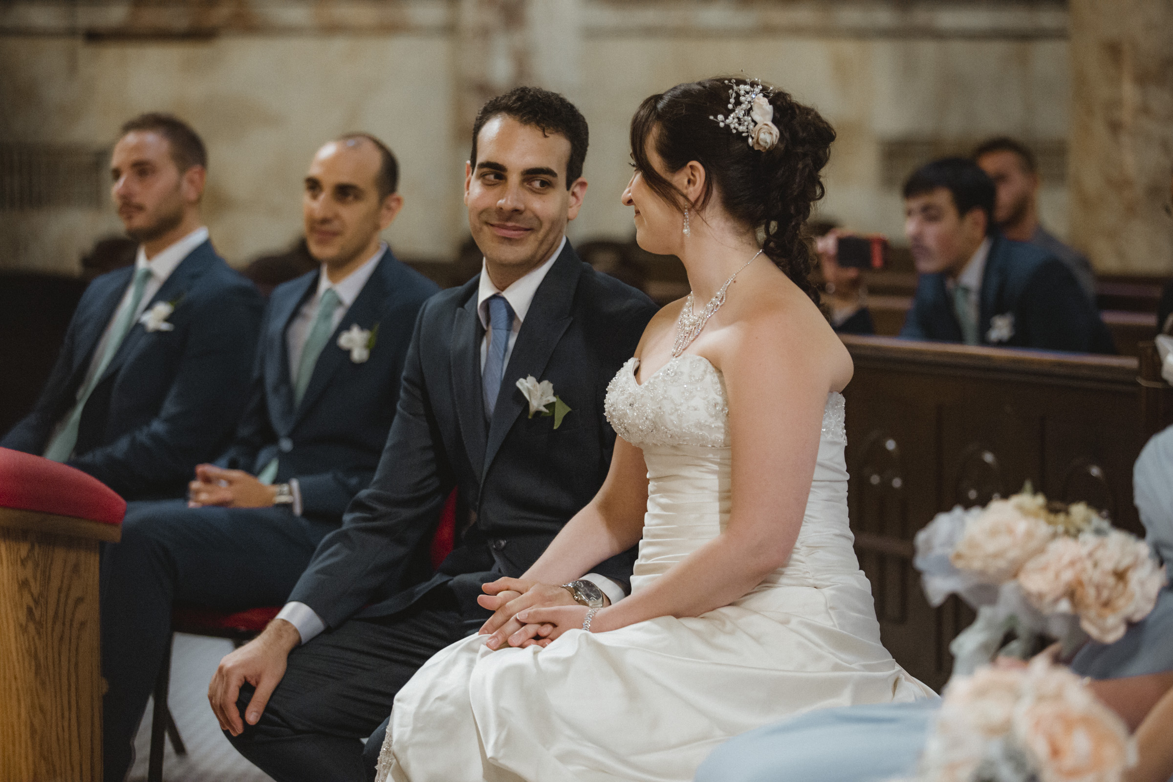 Bride and groom look at each other and smile during the ceremony | Our Lady of Pompeii wedding | Manhattan wedding | Bronx Wedding | Cathy & Antonello's wedding | Amy Sims Photography