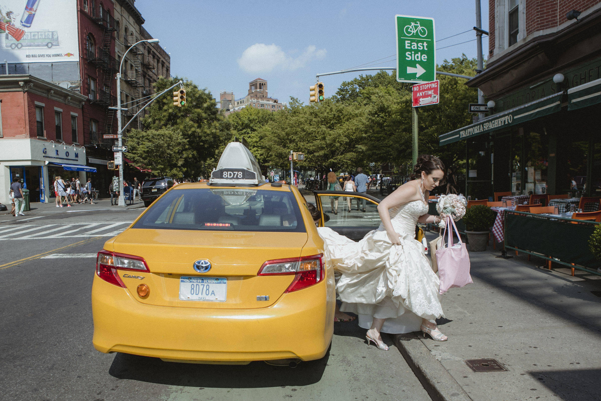 Bride exits NY yellow cab in her Maggie Sottero gown  | Manhattan wedding | Bronx Wedding | Cathy & Antonello's wedding | Amy Sims Photography