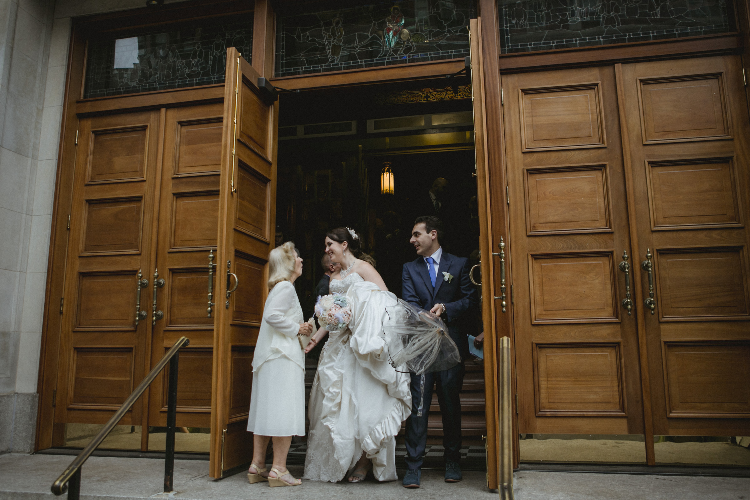Guest congratulates newlyweds | Our Lady of Pompeii wedding | Manhattan wedding | Bronx Wedding | Cathy & Antonello's wedding | Amy Sims Photography