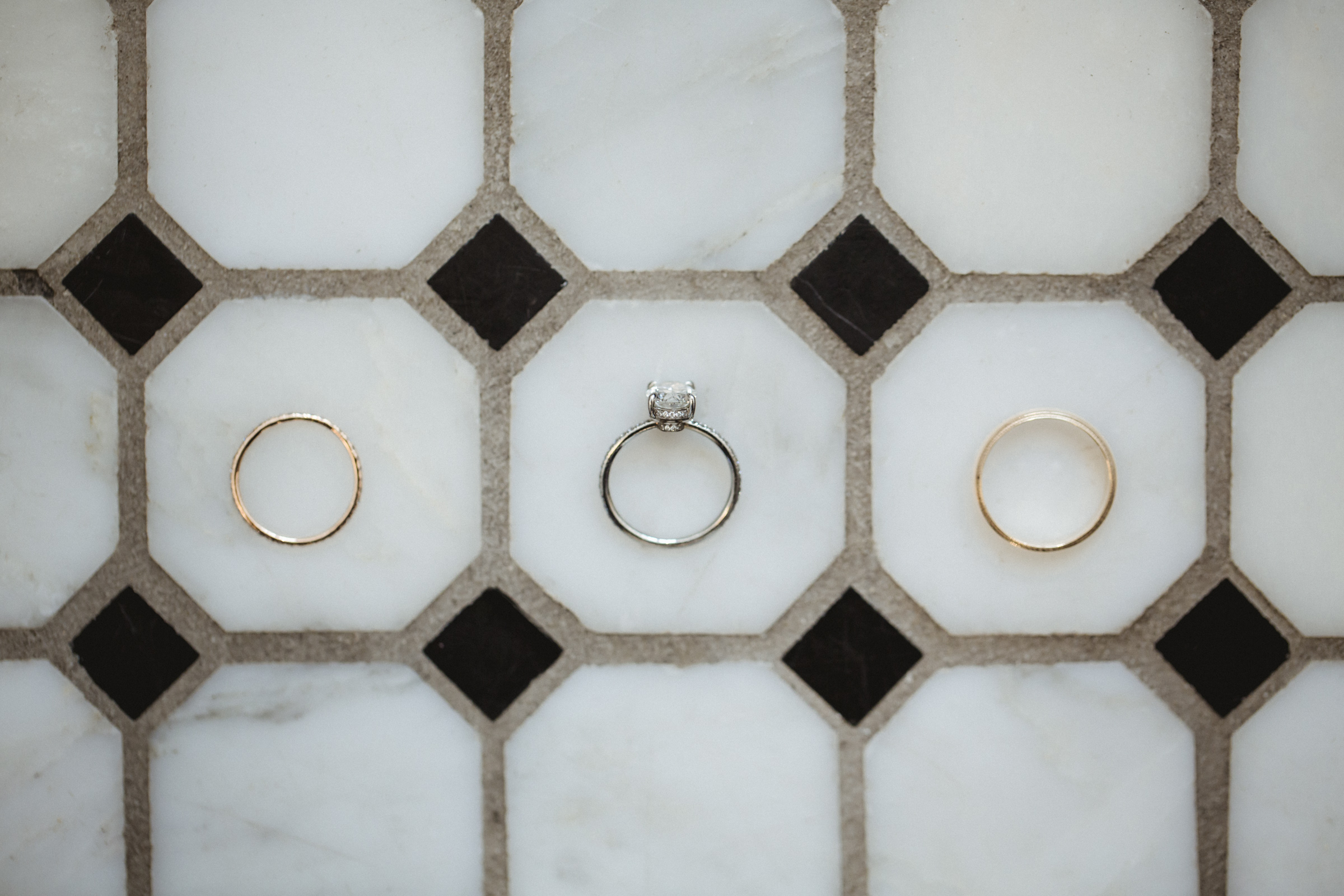 Amy Sims Photography | Rings spaced out on geometric marble tiles | New York Wedding Photographer | Manhattan Wedding Photographer