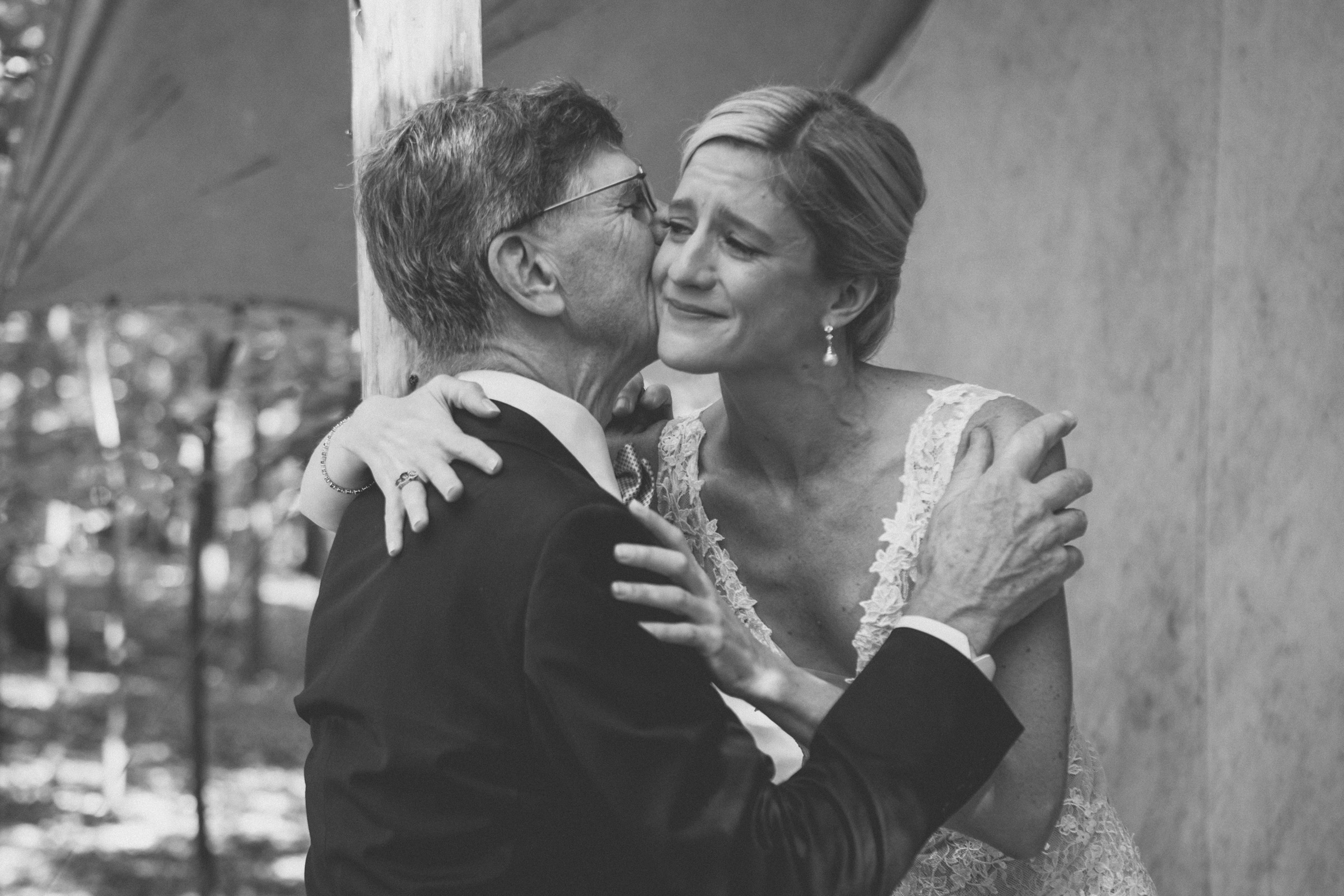 Amy Sims Photography | Bride cries as she hugs her father | Emmerich Tree Farm Wedding | black and white photography | Hudson Valley Wedding Photographer