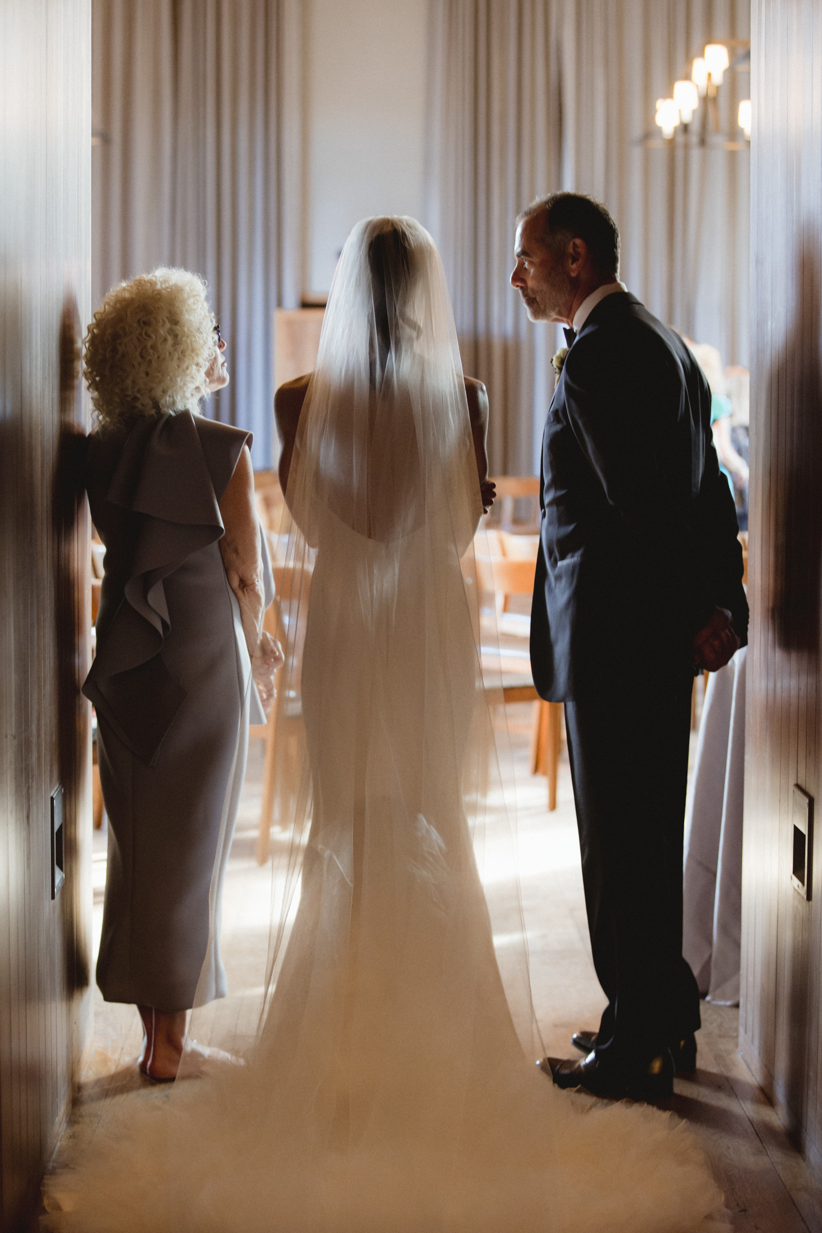 Amy Sims Photography | Bride and parents stand silhouetted in hallway | Blue Hill Farm Wedding | Westchester Wedding Photographer | New York Wedding Photographer