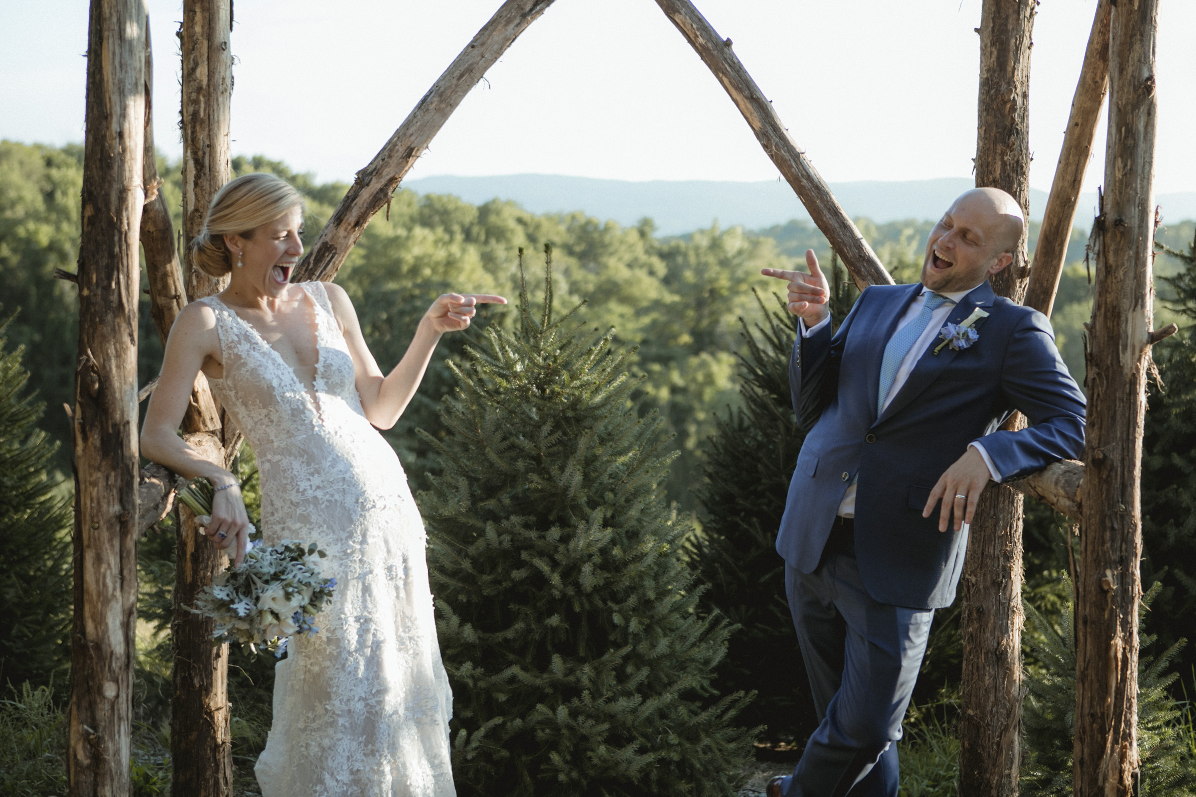 Amy Sims Photography | Bride and Groom point finger guns and smile at each other  | Emmerich Tree Farm Wedding | black and white photography | Hudson Valley Wedding Photographer