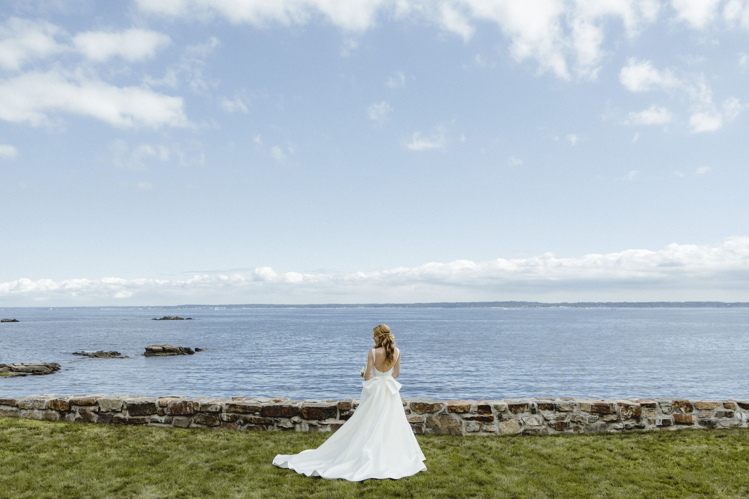 Amy Sims Photography | Bride stands facing a wide open river on a vibrate summer day | Westchester Wedding Photographer | New York Wedding Photographer