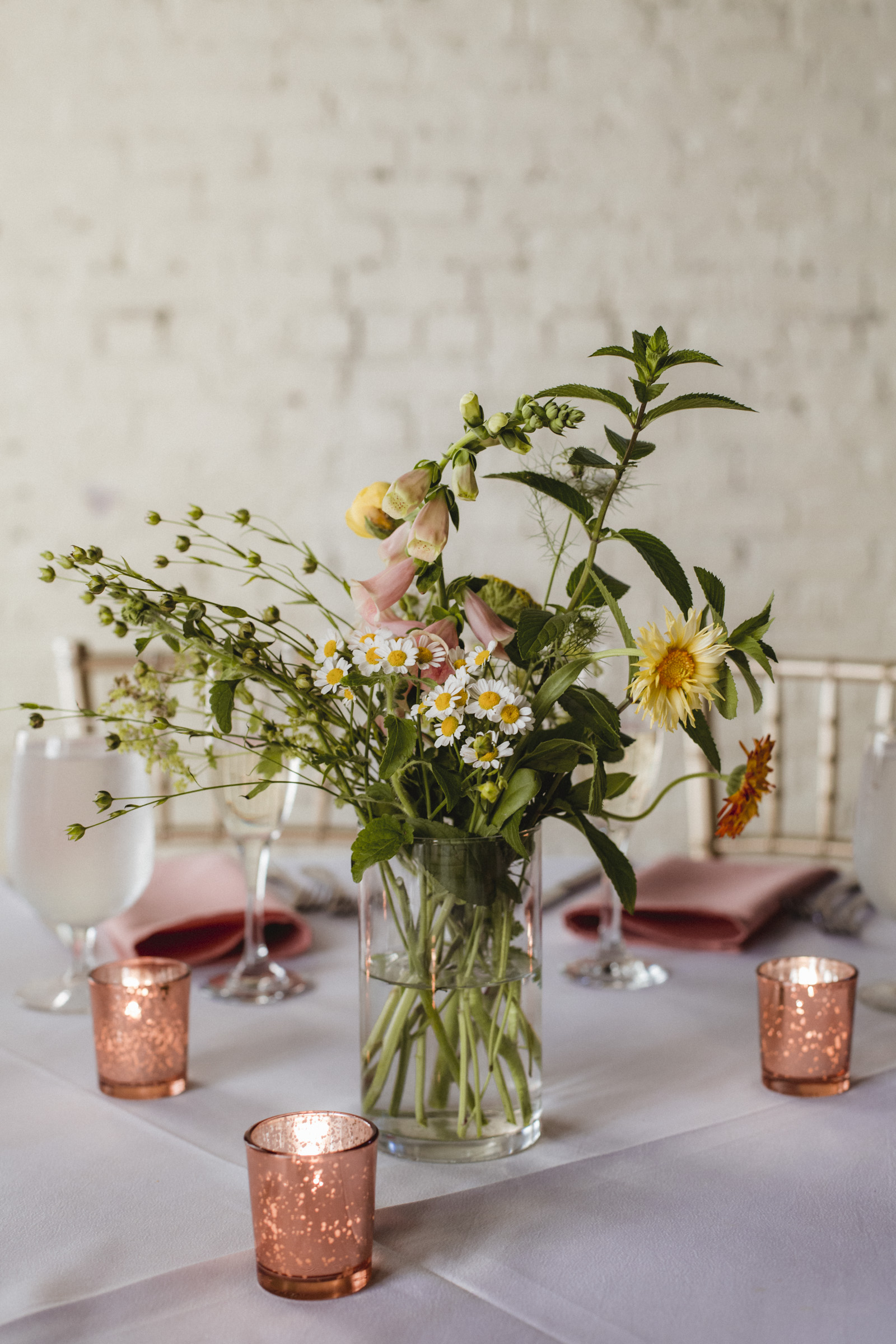 Amy Sims Photography | center piece of bright, cheerful daisies | Upstate New York Wedding Photographer