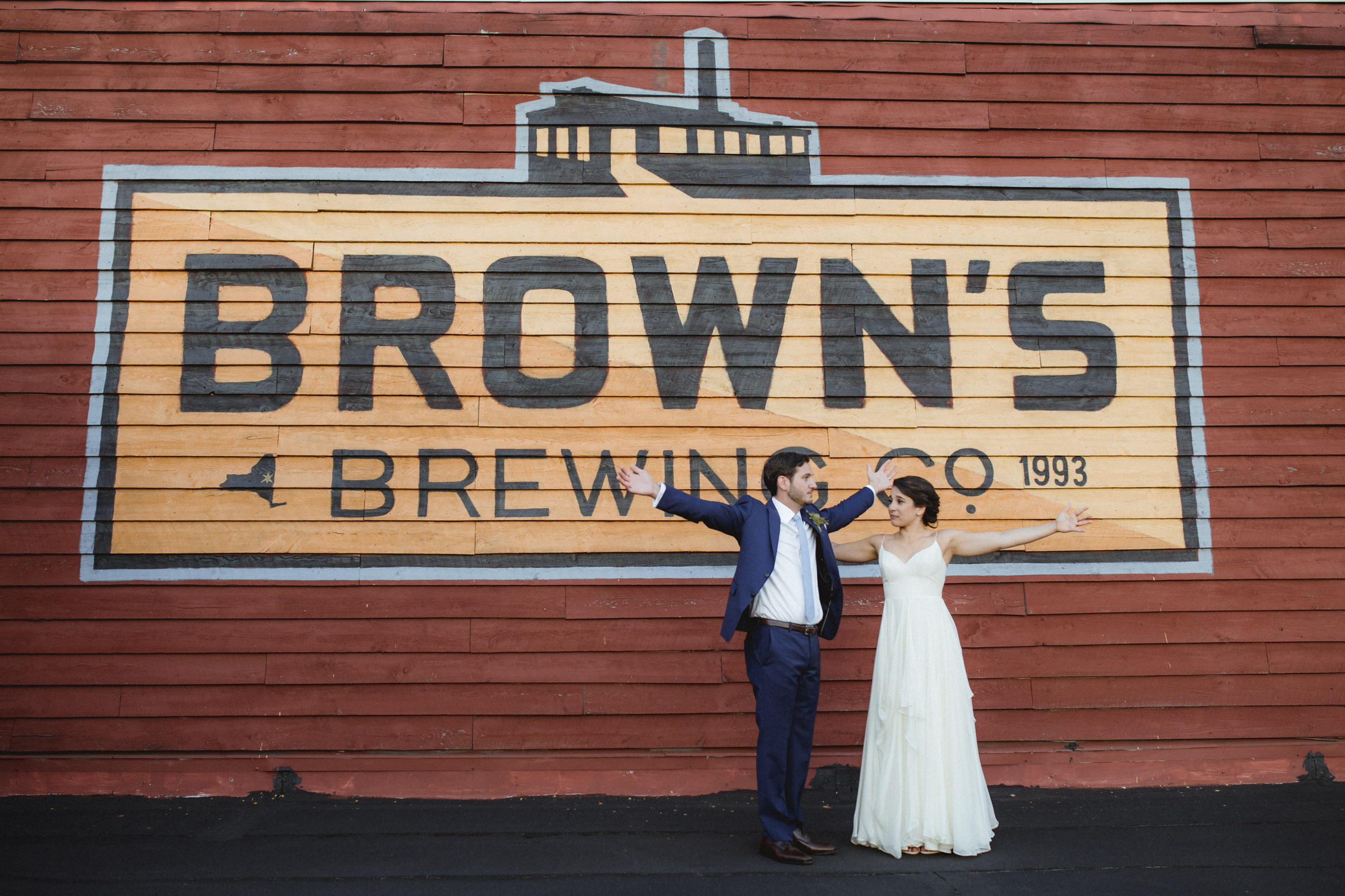 Amy Sims Photography | Couple stands with arms comically wide open  | Upstate New York Wedding Photographer | New York Wedding Photographer