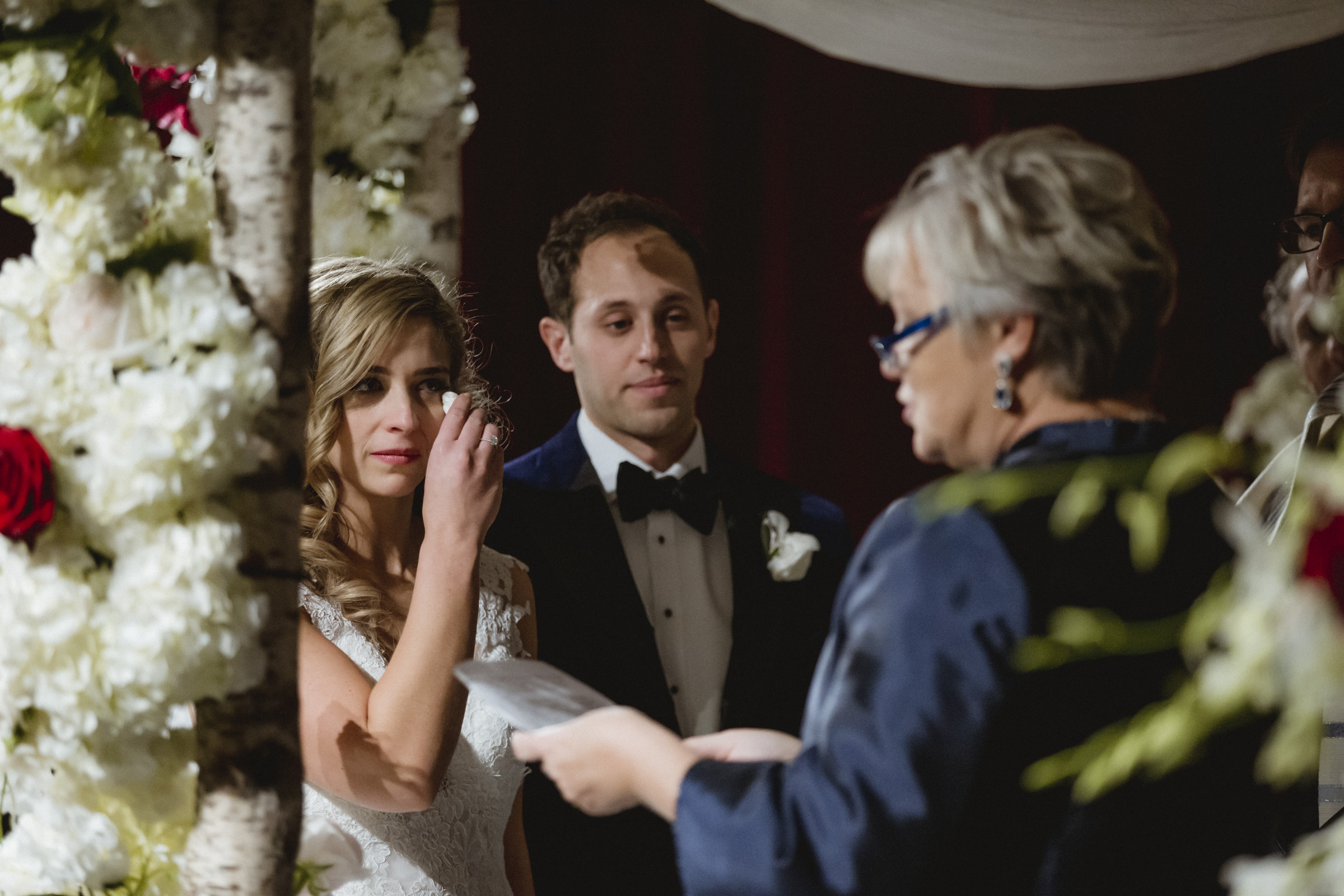 Amy Sims Photography | Bride wipes away a tear during a touching reading during the ceremony | New York wedding photographer | Manhattan wedding photographer | NYU wedding