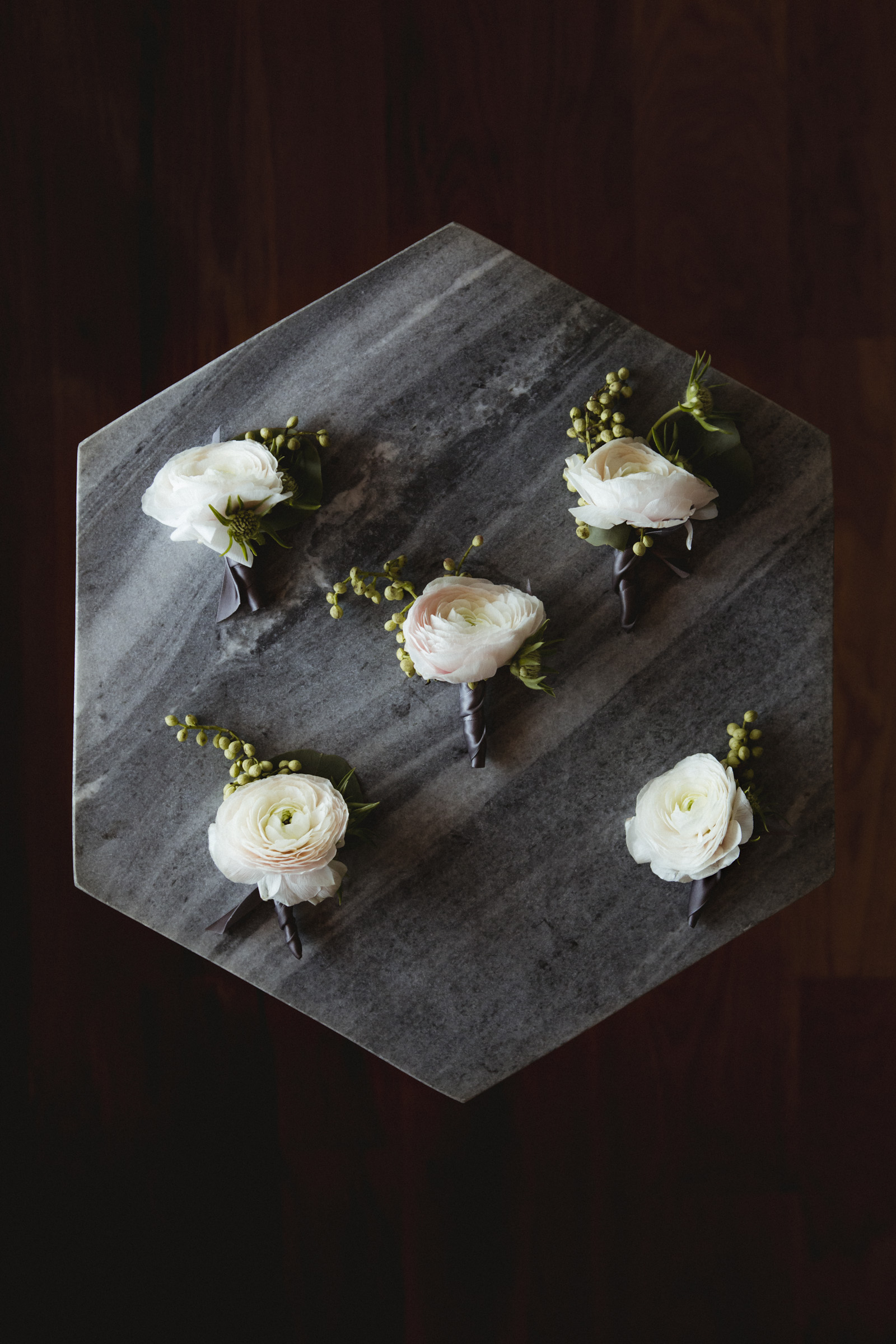 Amy Sims Photography | boutonnieres laid out on a hexagon shaped marble table | Box House Hotel Wedding | Brooklyn Wedding Photographer | New York Wedding photographer