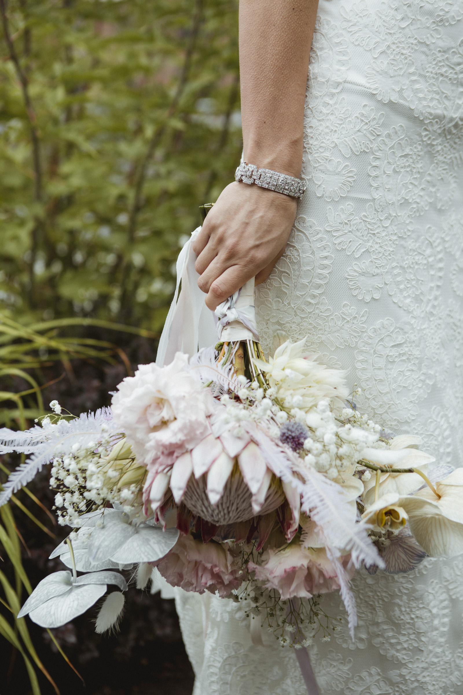 Amy Sims Photography | bride lets her ornate bouquet hang down by her side | Liberty Warehouse wedding | Brooklyn Wedding Photographer