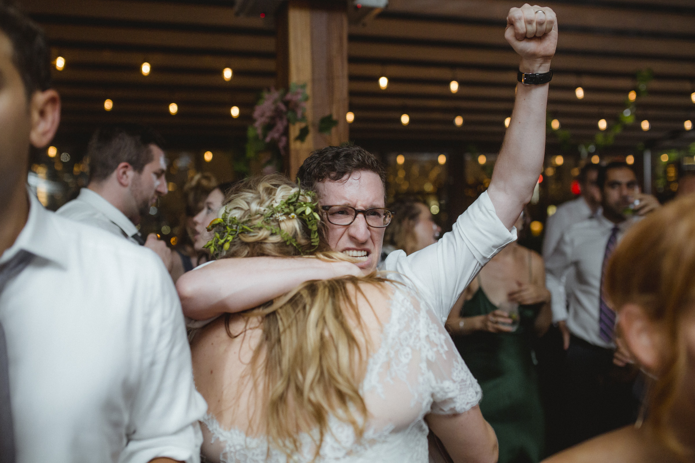 Amy Sims Photography | Groom holds his bride close with a fist in the air, celebrating his new wife | Box House Hotel Wedding | Brooklyn wedding photographer