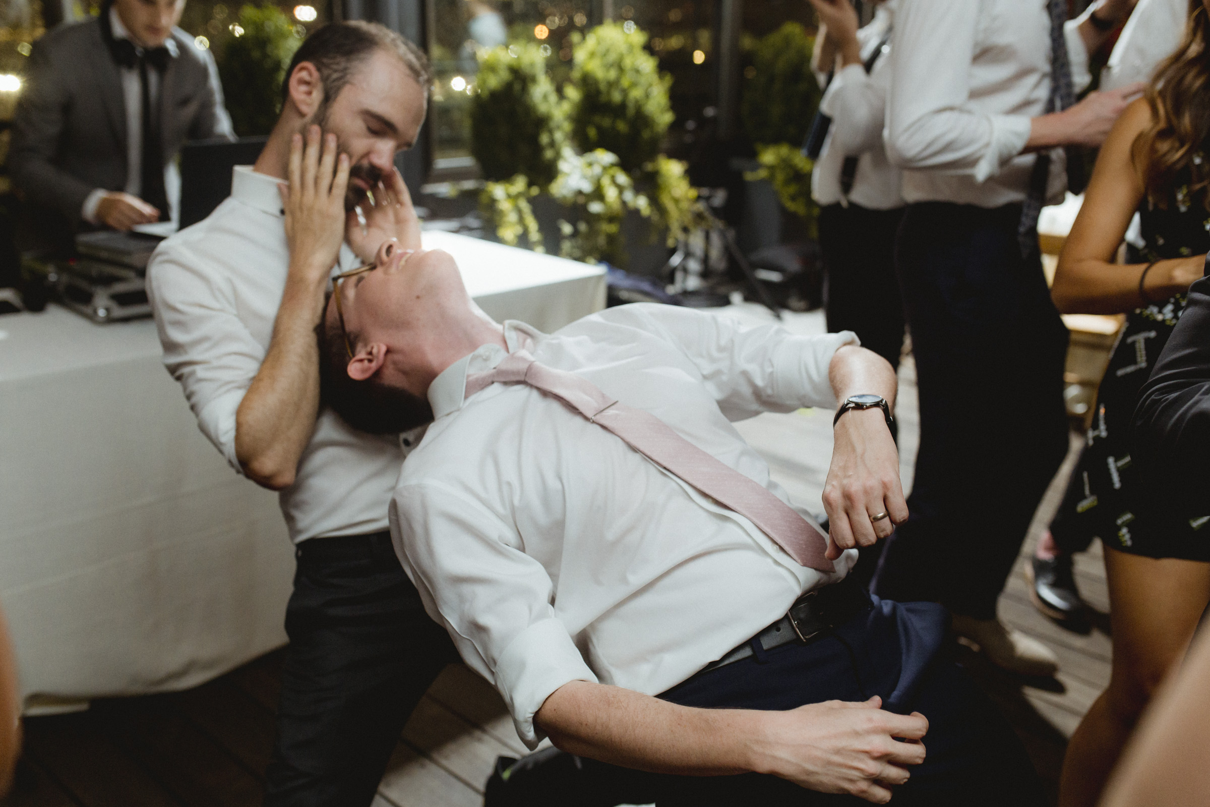 Amy Sims Photography | groom leans back on to the legs of a friend as they dance | Box House Hotel wedding | Brooklyn wedding photographer