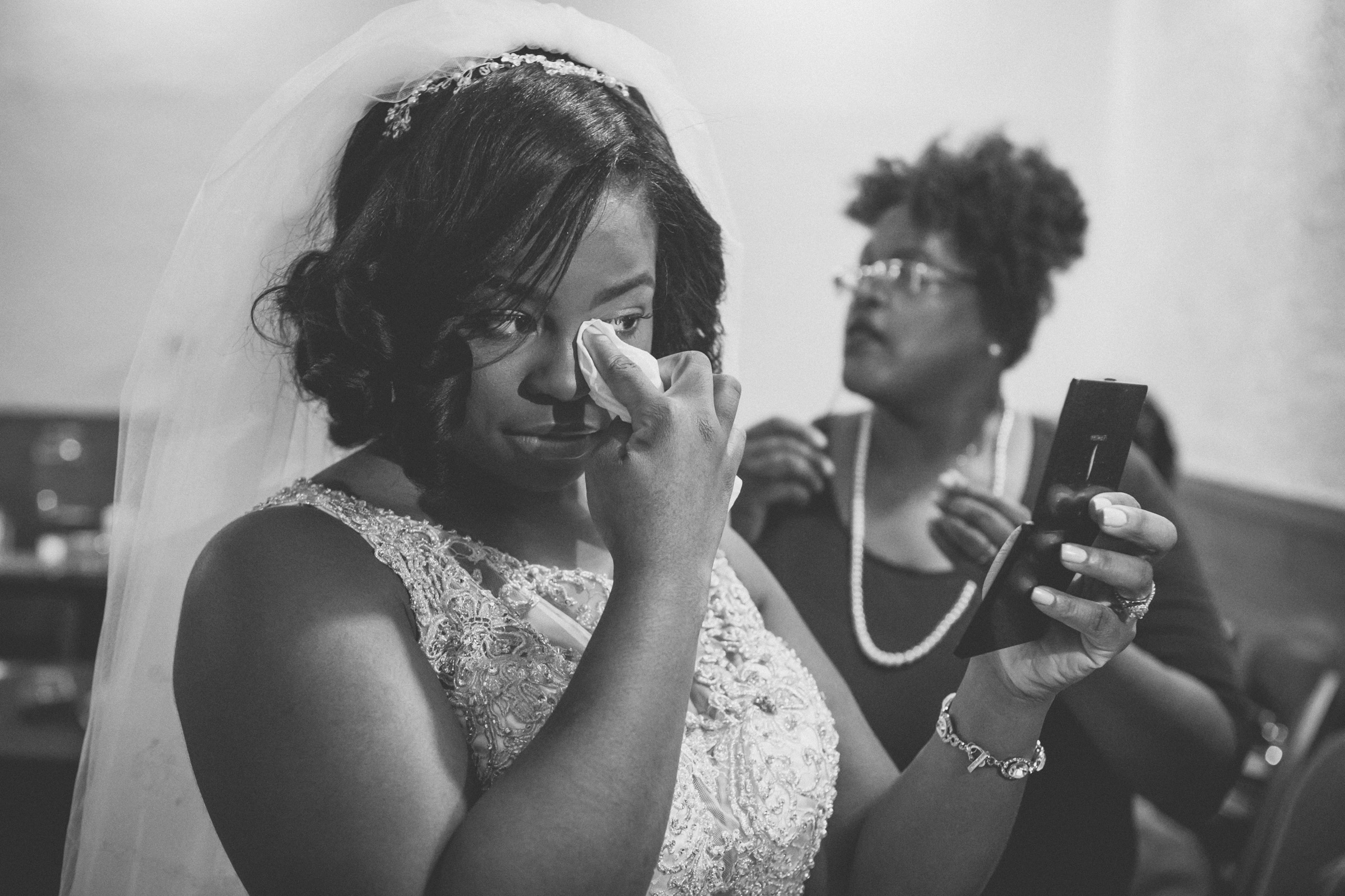 Amy Sims Photography | Bride touches up her makeup | Greater St. Stephen United Church of God | New York Wedding Photographer | Brooklyn Church Wedding