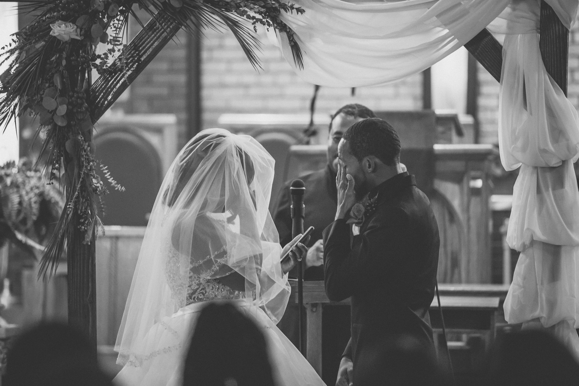 Amy Sims Photography | Bride and groom wipe away tears | Greater St. Stephen United Church of God | New York Wedding Photographer | Brooklyn Church Wedding