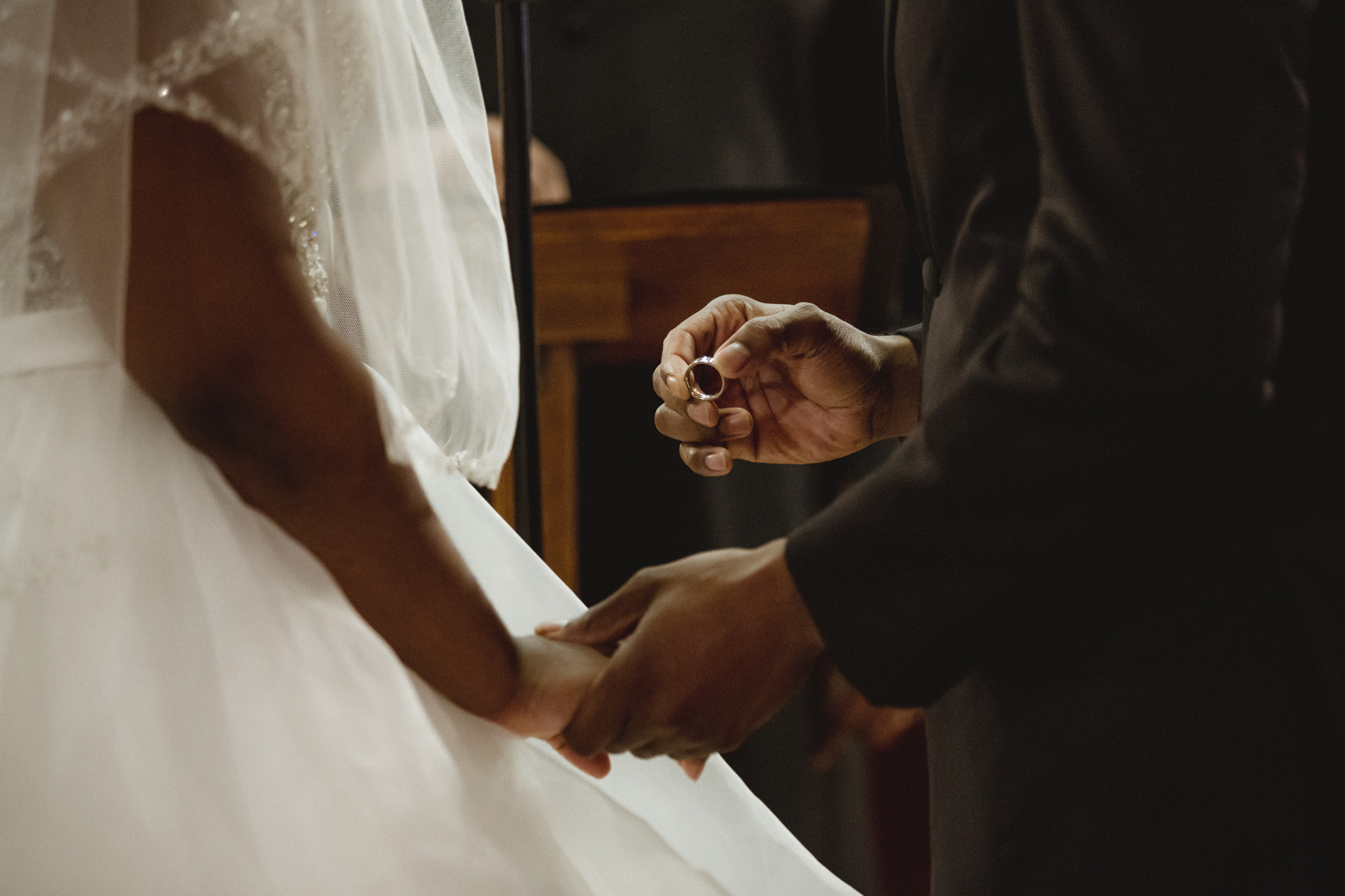 Amy Sims Photography | Groom holds ring before placing it on Bride's finger | Greater St. Stephen United Church of God | New York Wedding Photographer | Brooklyn Church Wedding