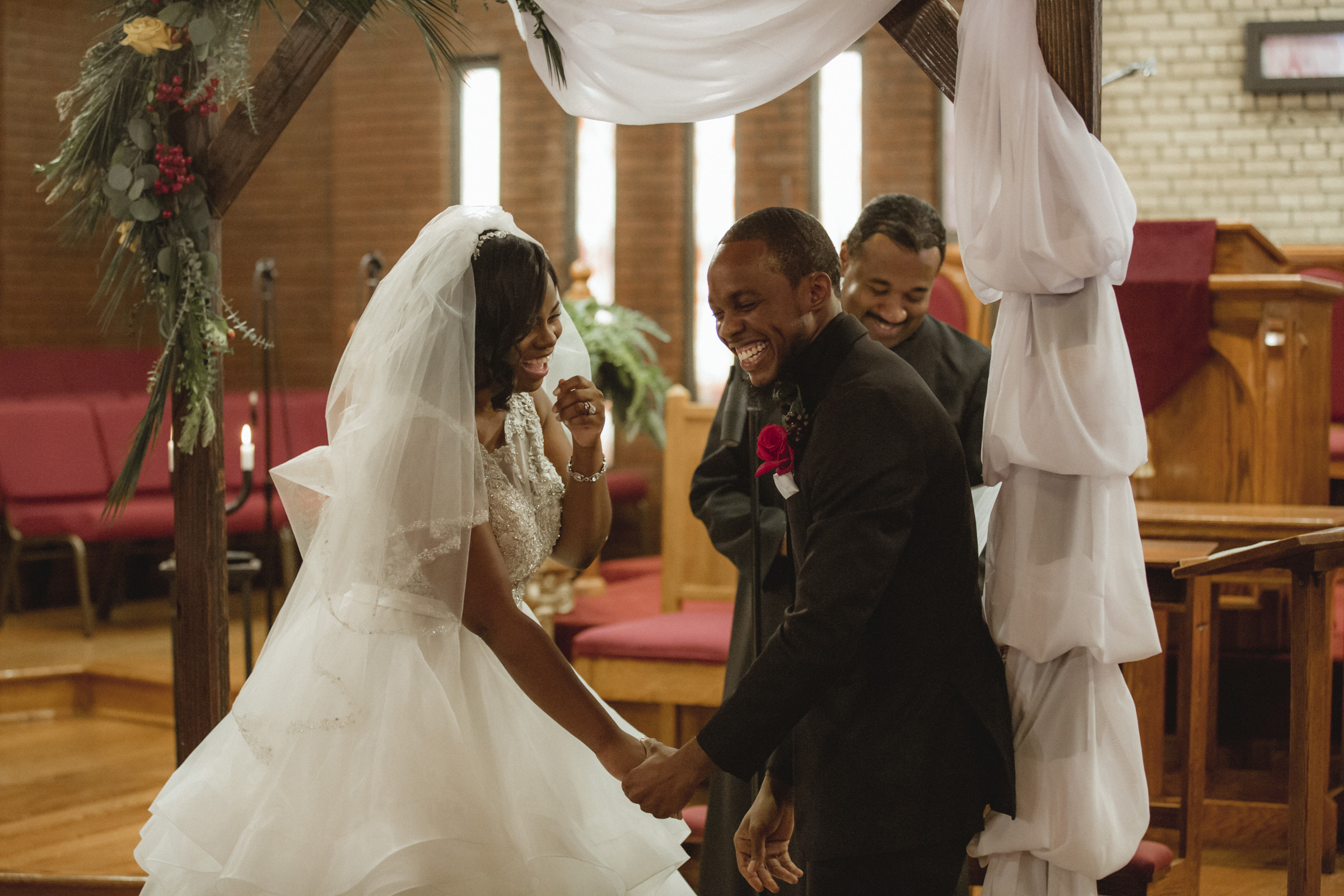Amy Sims Photography | Bride and Groom laugh with pastor during ceremony | Greater St. Stephen United Church of God | New York Wedding Photographer | Brooklyn Church Wedding