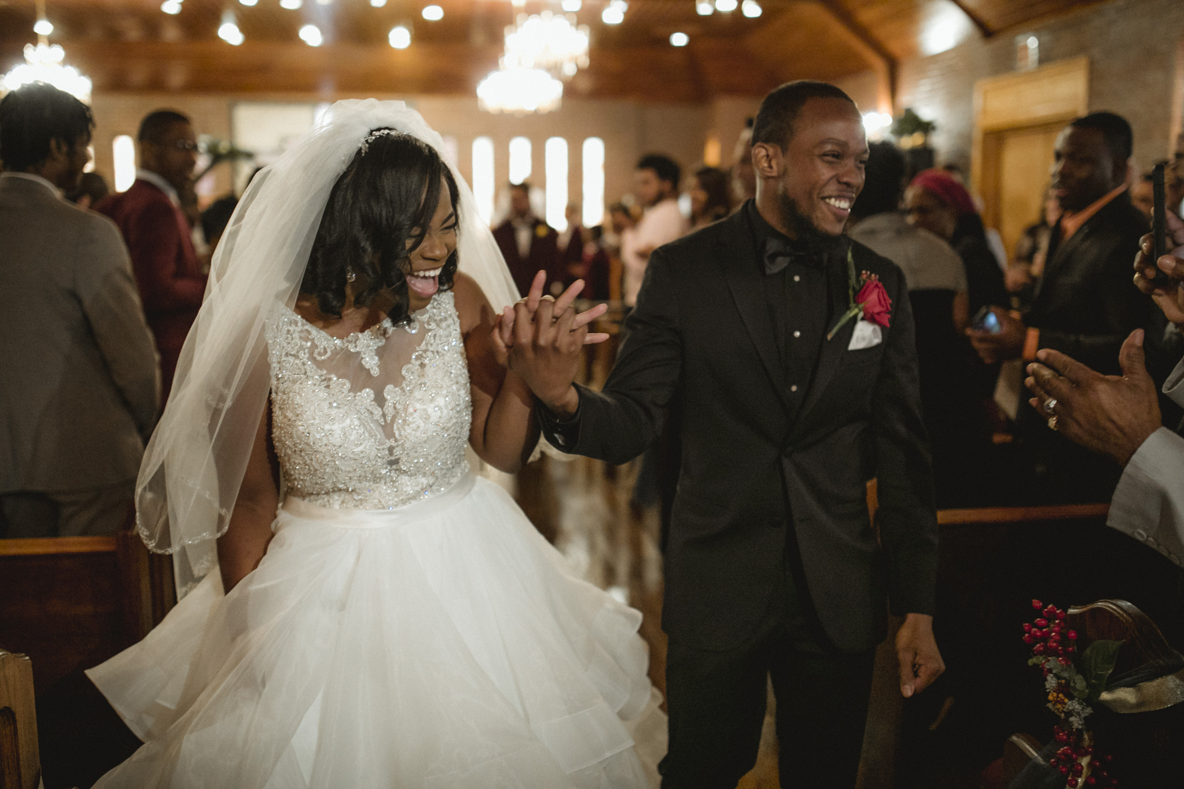 Amy Sims Photography | Newlyweds celebrate, coming back down the aisle | Greater St. Stephen United Church of God | New York Wedding Photographer | Brooklyn Church Wedding