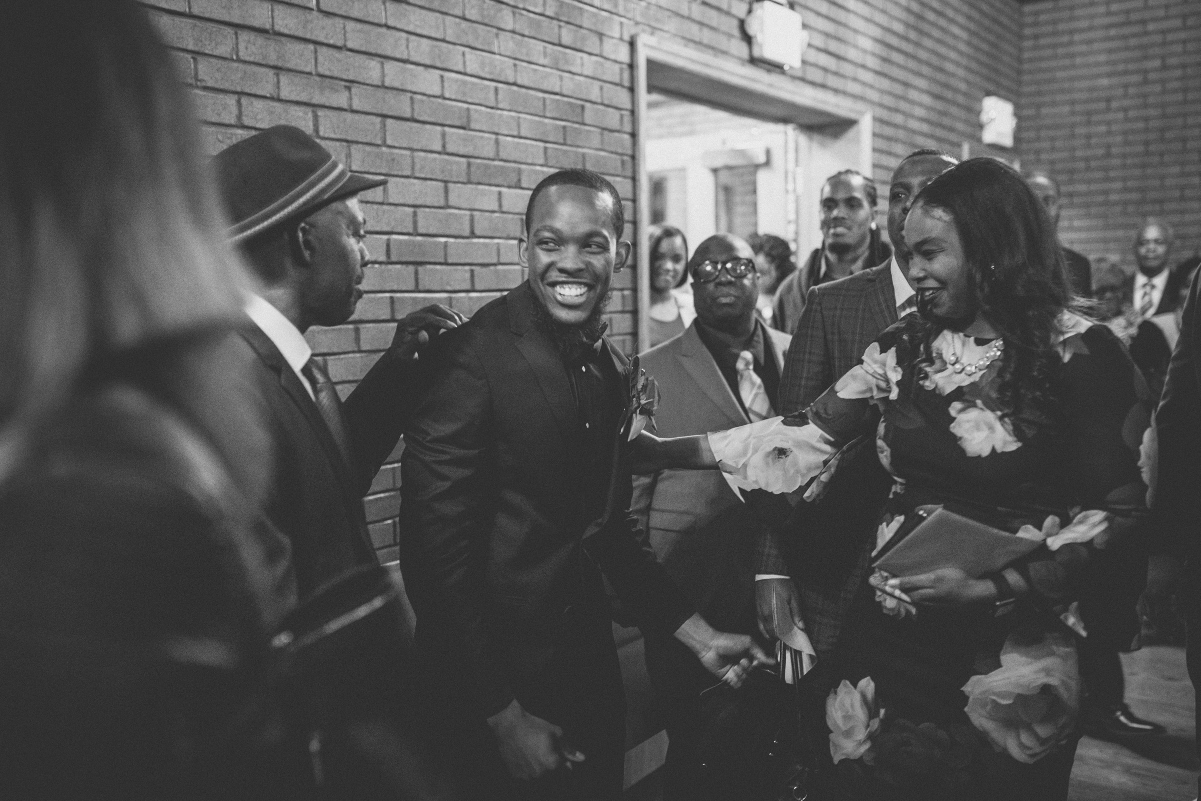 Amy Sims Photography | Guests congratulate groom | Greater St. Stephen United Church of God | New York Wedding Photographer | Brooklyn Church Wedding