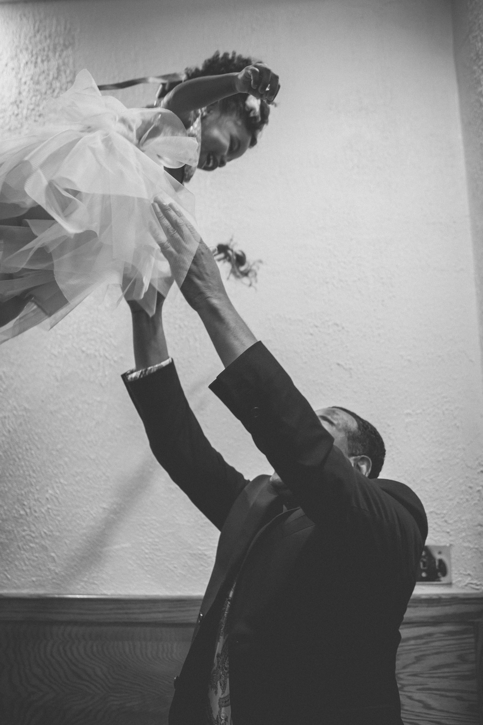 Amy Sims Photography | Flower girl giggles while being thrown in the air | Greater St. Stephen United Church of God | New York Wedding Photographer | Brooklyn Church Wedding