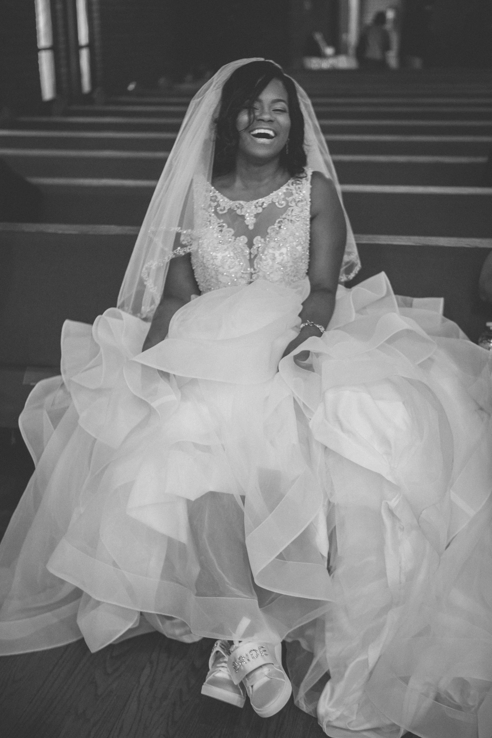Amy Sims Photography | Bride shows off her bridal sneakers | Greater St. Stephen United Church of God | New York Wedding Photographer | Brooklyn Church Wedding