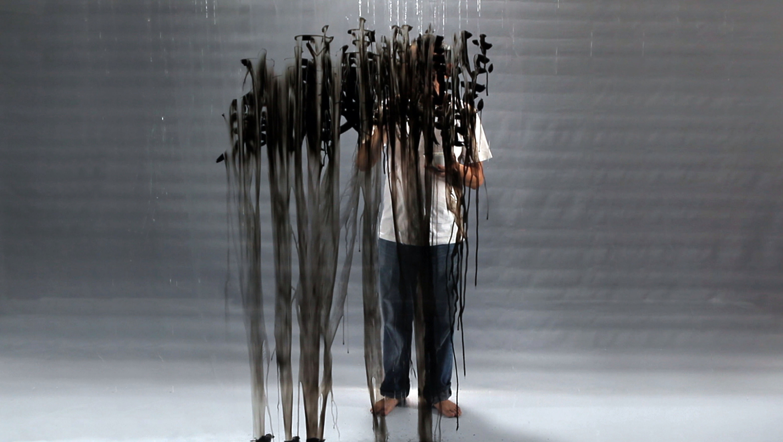 FX Harsono,  Writing in the Rain  (still), 2011, single channel video, 6:02 minutes, edition of 5. Courtesy of the artist.