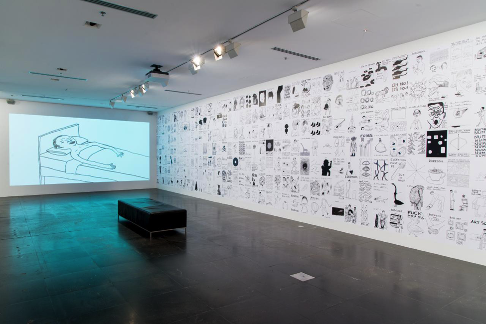 David Shrigley,  Untitled drawings  2004–14, inkjet prints, wheat paste, 330 x 1450 cm (overall), installation view, National Gallery of Victoria.