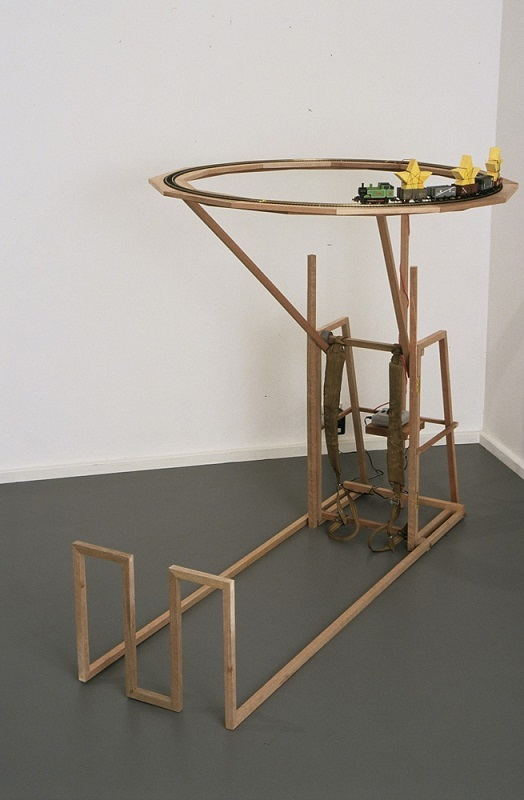 Roy Ananda,  Concussion device , 2005, Timber, webbing, cardboard, thread, gouache, model train set. Photograph by Mick Bradley. Image courtesy of the artist.